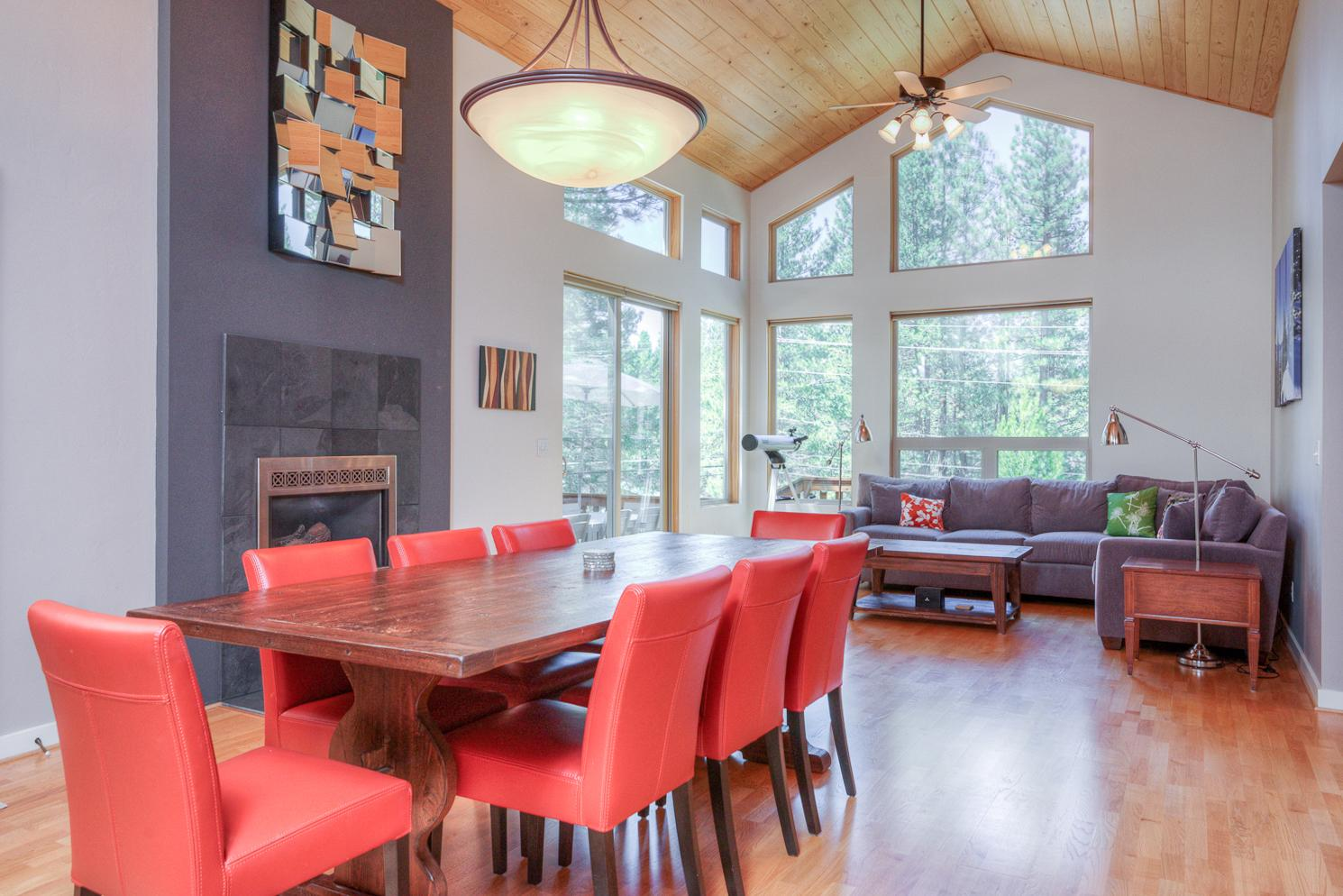 Share a meal at the modern, 8-person dining table beside the gas fireplace.