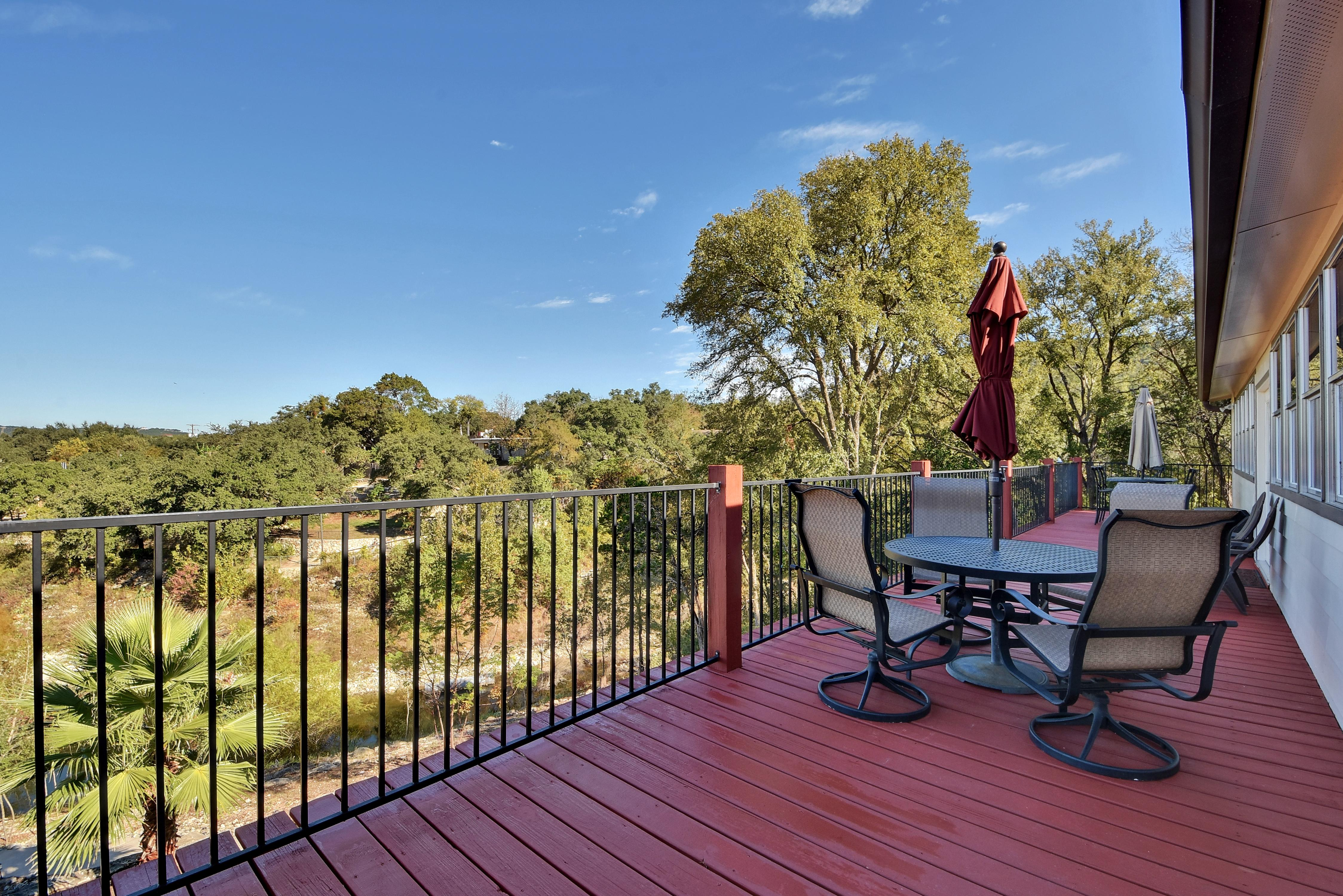 Relax on the upper deck with water views and a shaded dining table for 4.