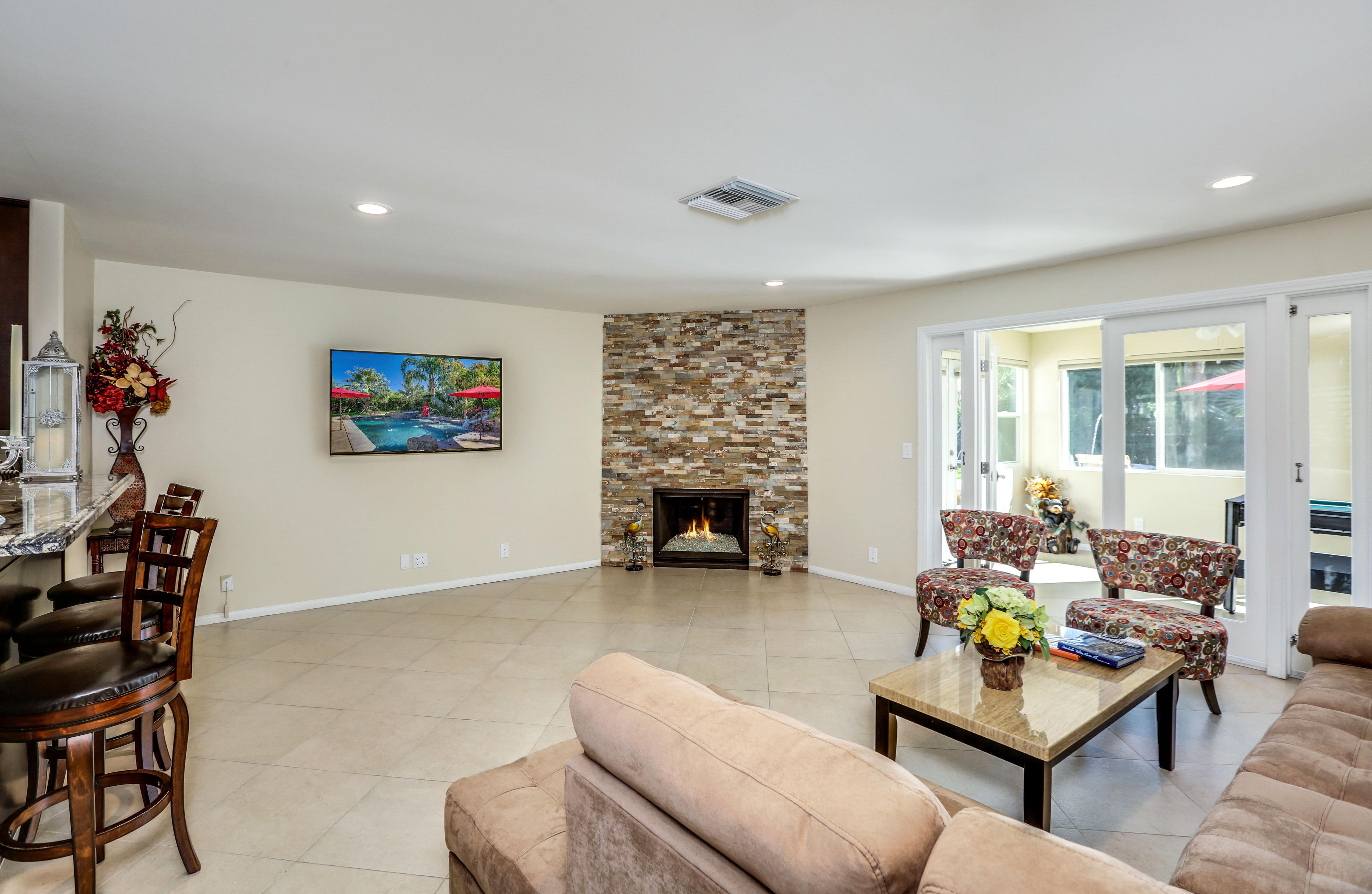 Sprawl out on a sectional and 2 accent chairs while the fireplace warms the open living space.
