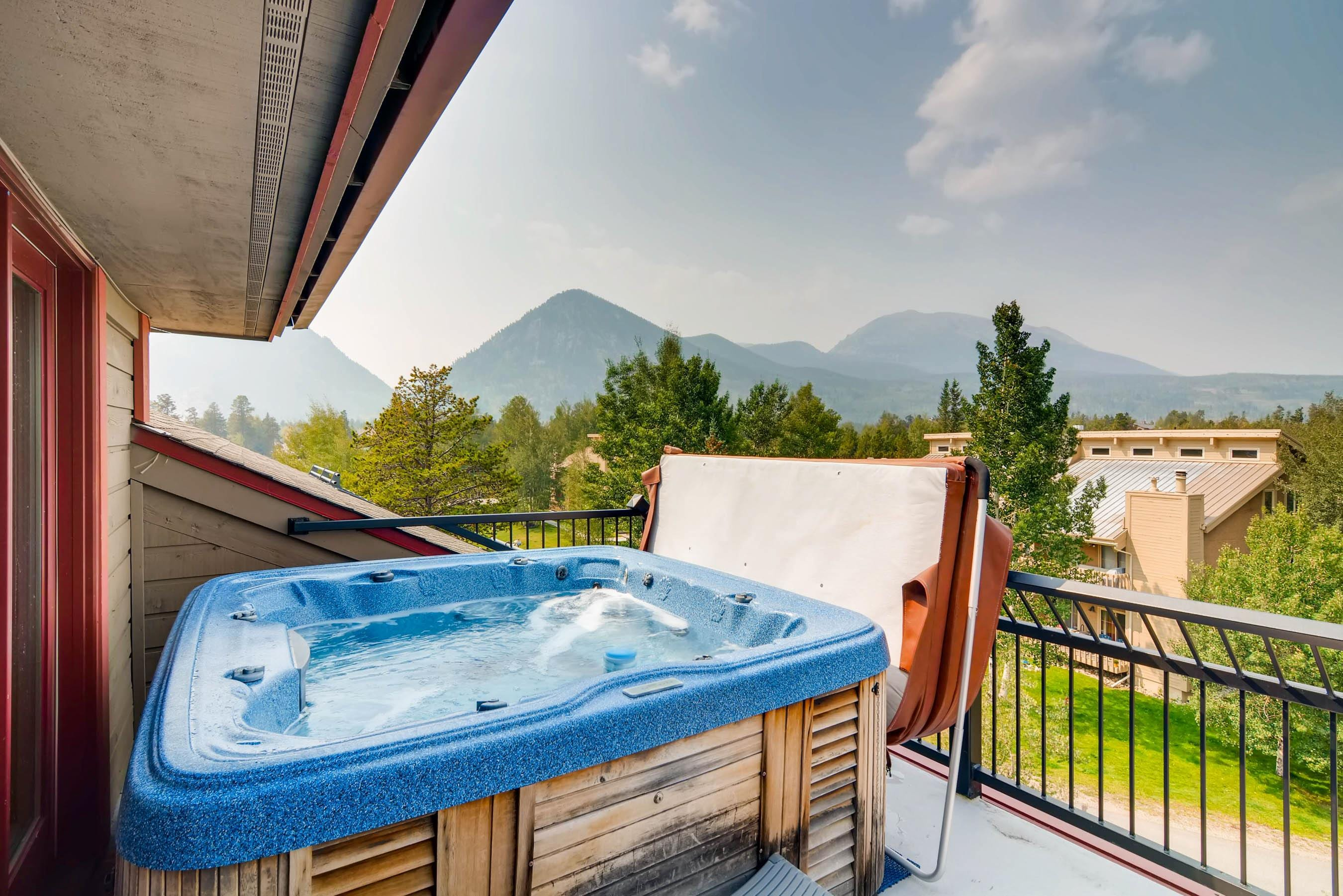 Soak in the outdoor hot tub and drink in the mountain views.