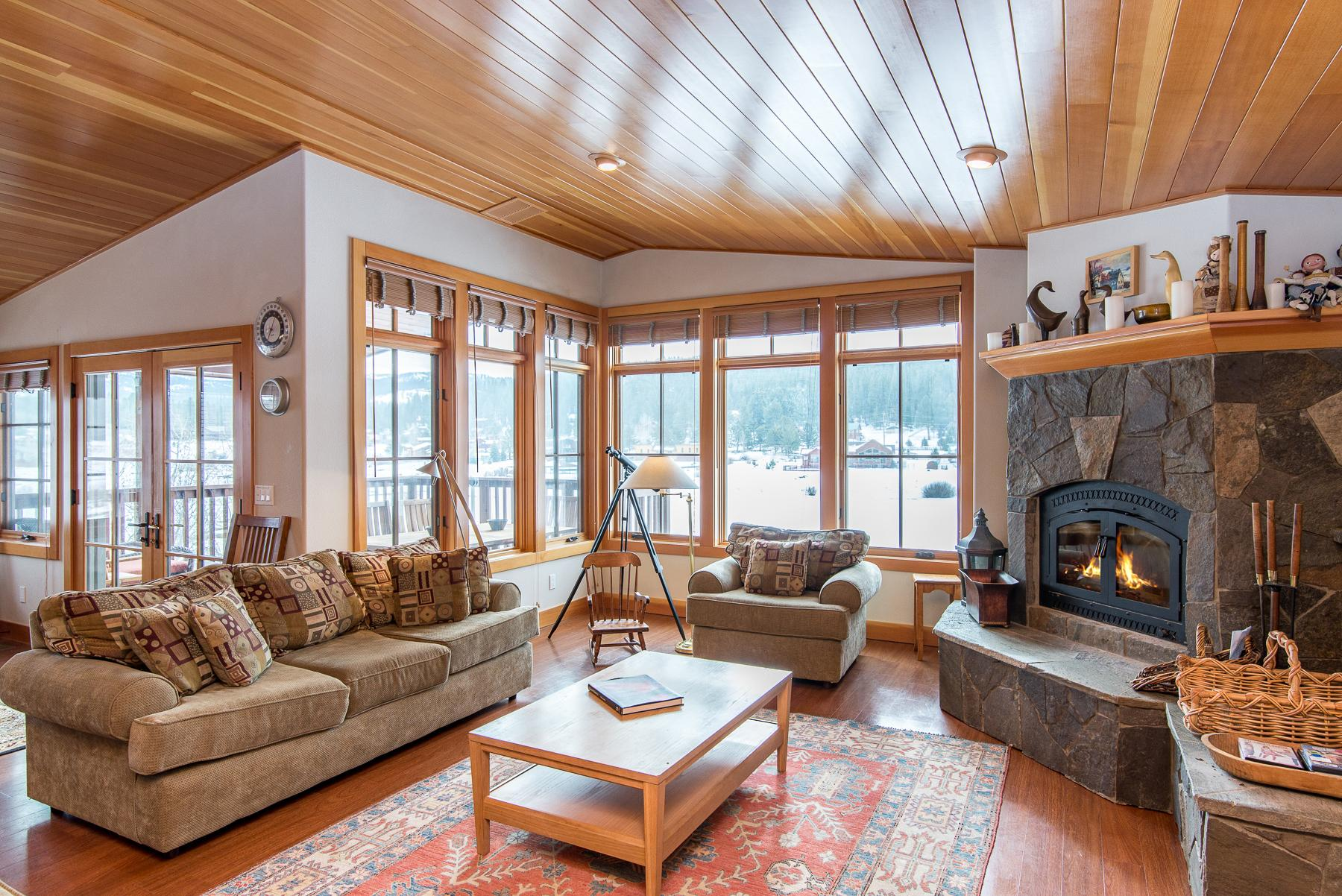 Welcome to Truckee! Your rental is professionally managed by TurnKey Vacation Rentals. Enjoy serene pond views from the rustic-chic living room.