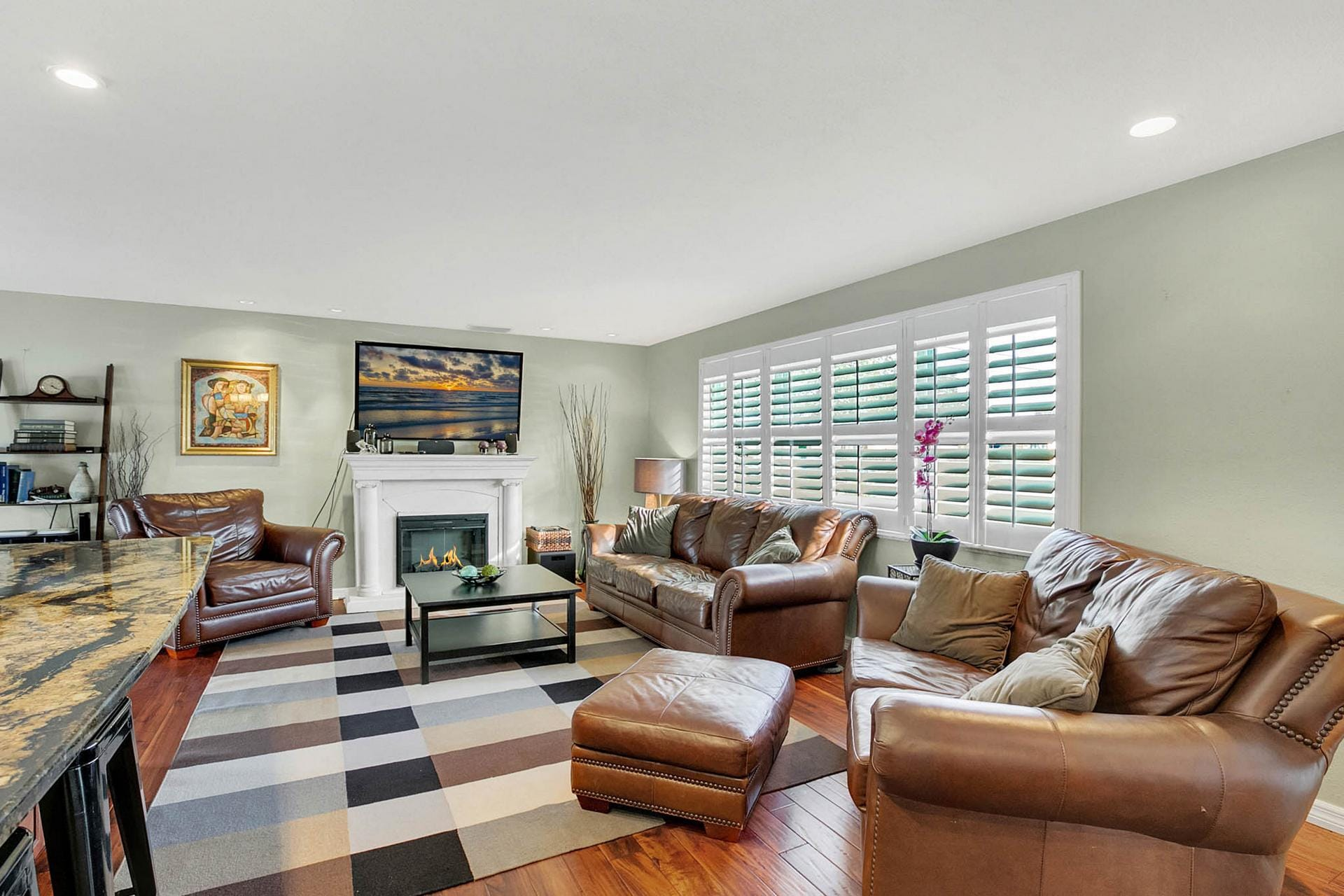 Recline on leather furniture by the fireplace and watch a 3D movie on the flat screen TV in the living room.