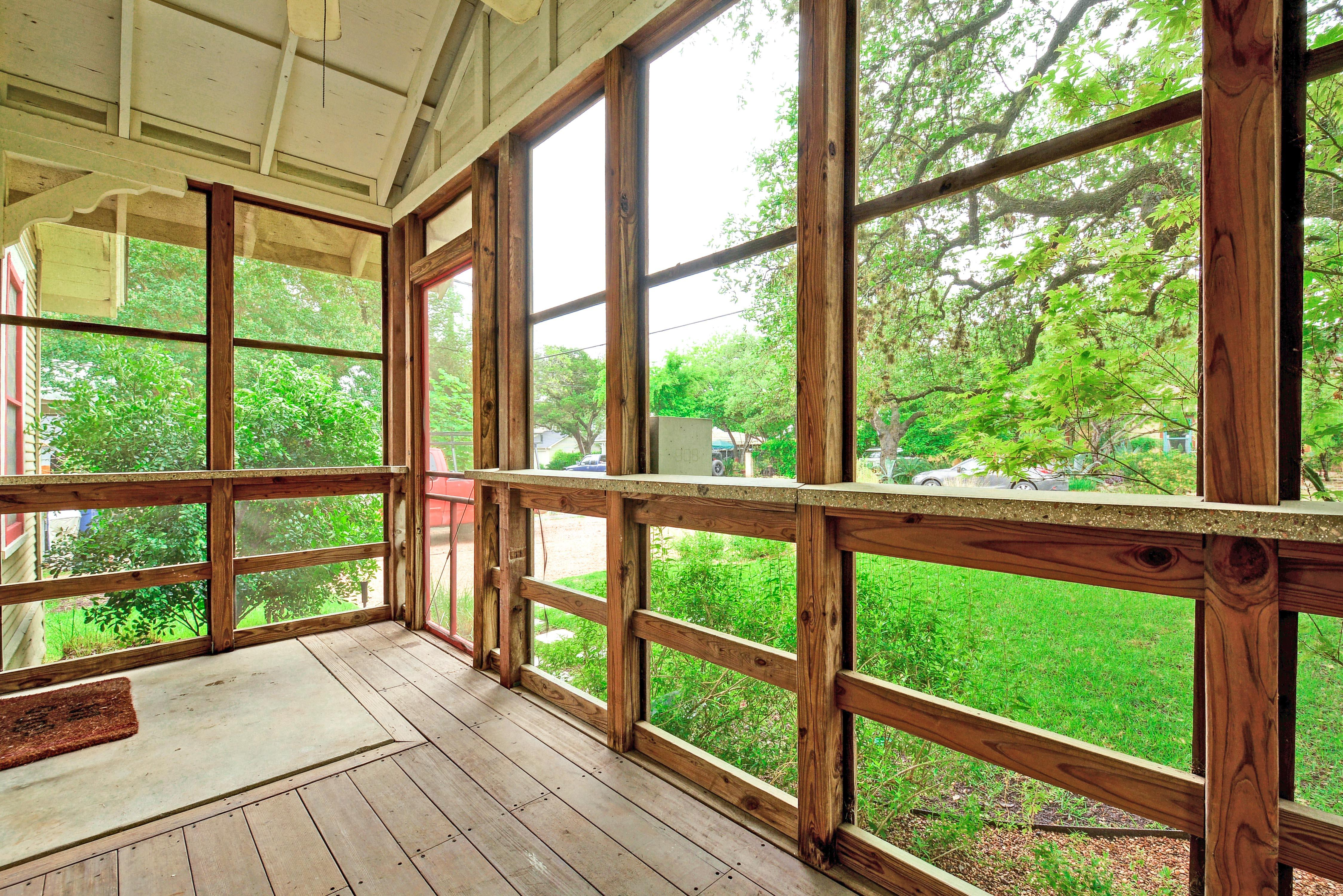 The screened front porch is a relaxing spot to enjoy morning coffee.
