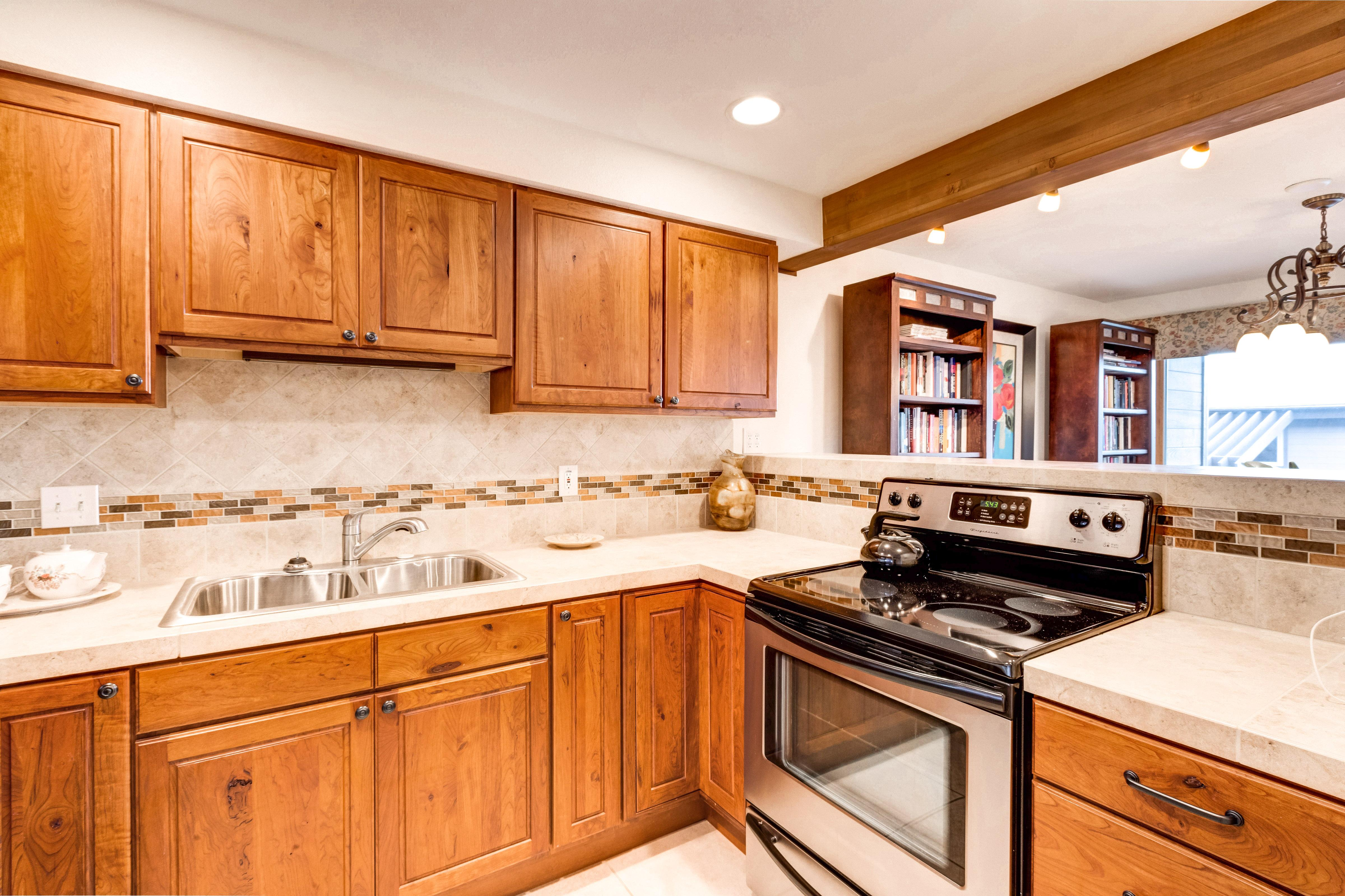 The large, well-equipped kitchen boasts stainless steel appliances and tiled countertops -- everything you'll need to prepare home cooked meals.