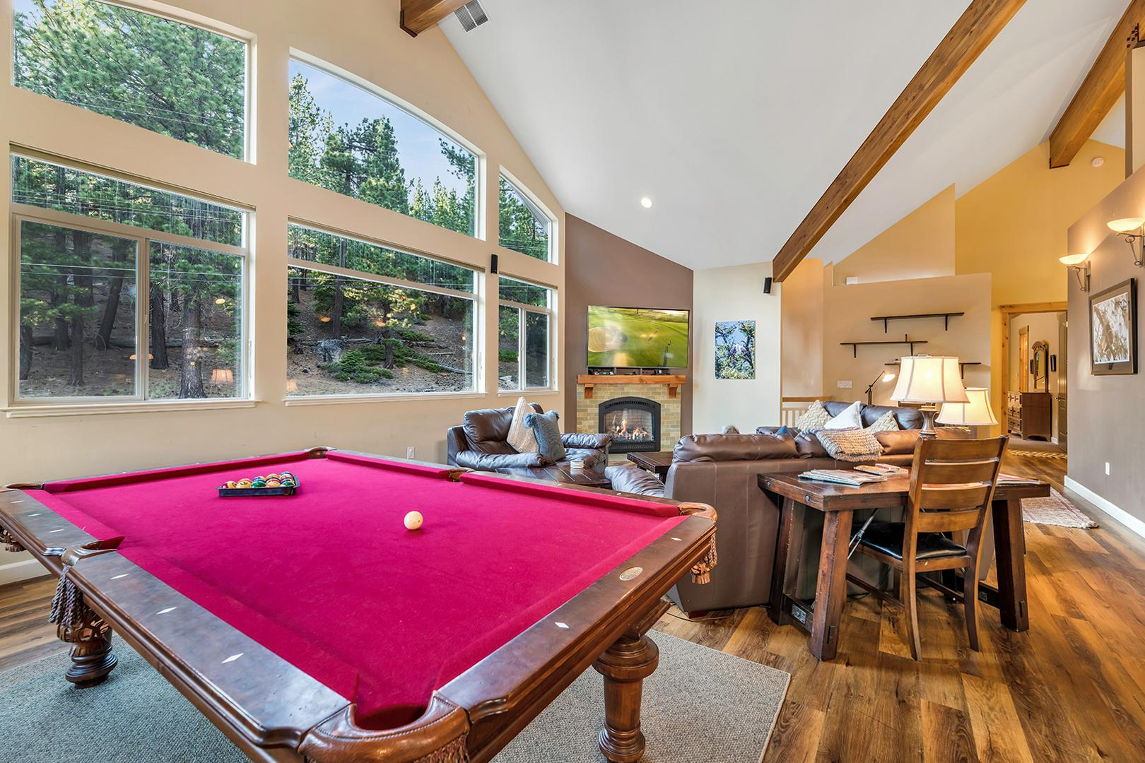 The light-filled living room is complete with a pool table.