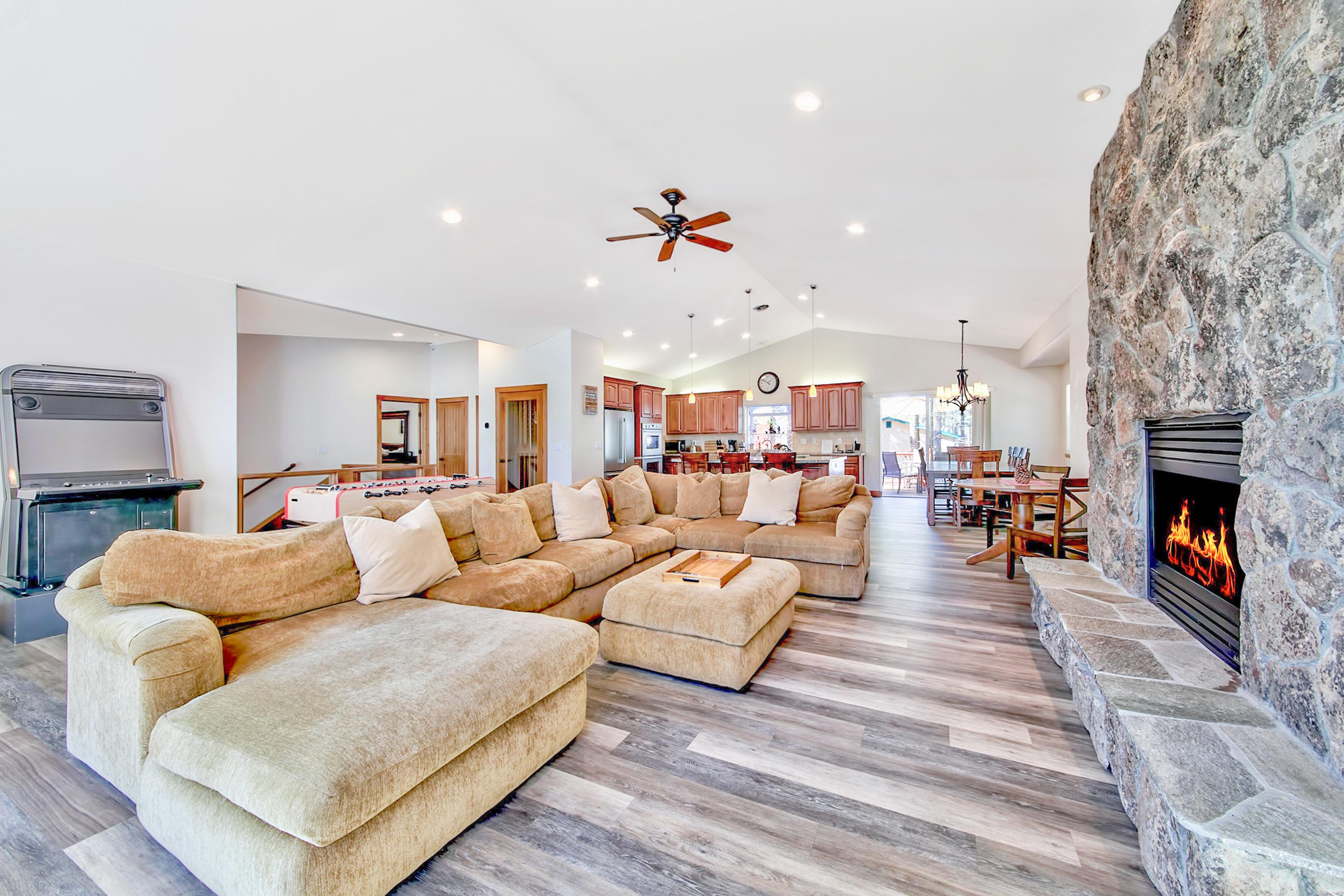 Welcome to South Lake Tahoe! The spacious living room features vaulted ceilings and a stone fireplace.