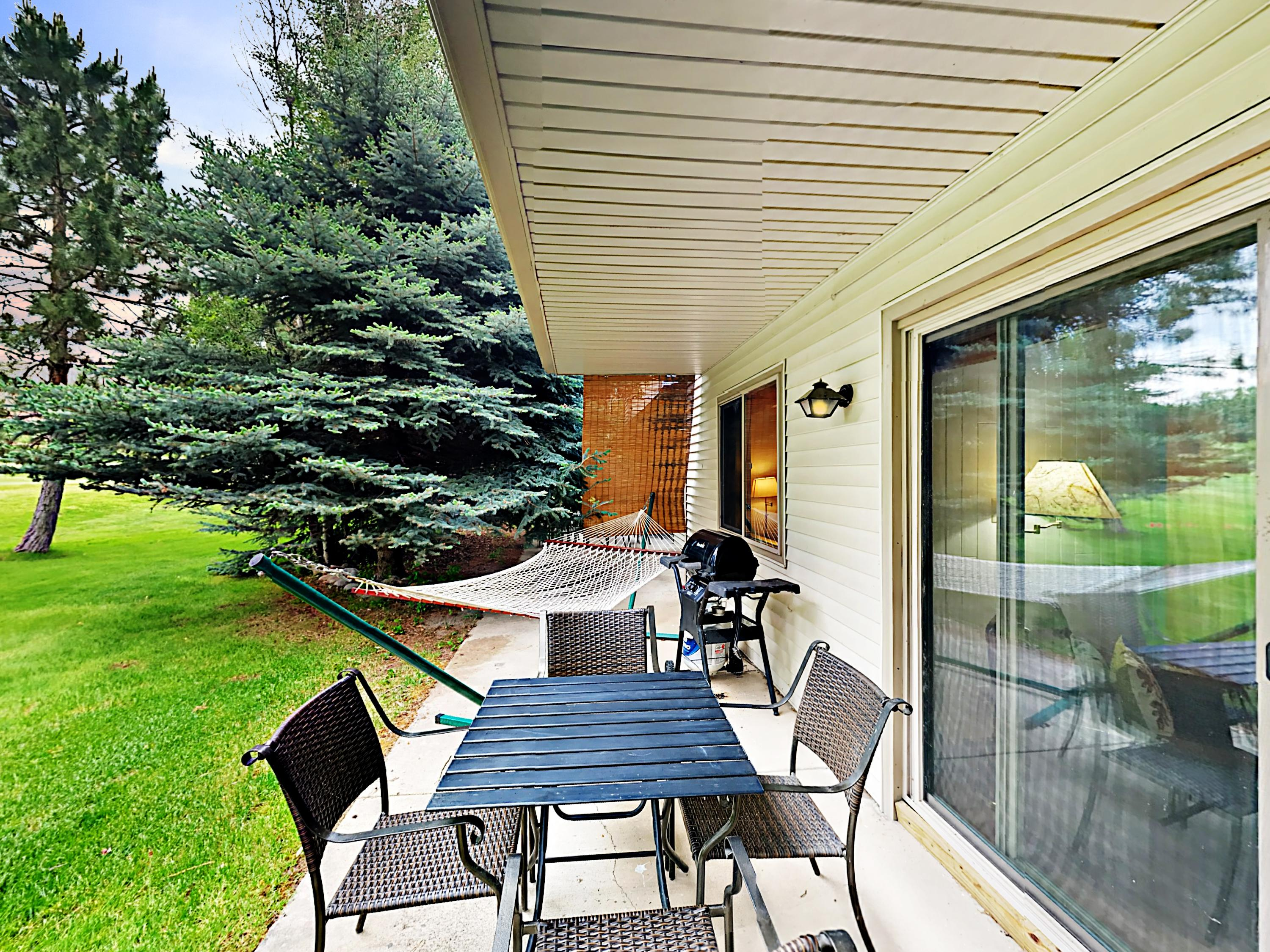 Your outdoor deck (which overlooks the golf course) is complete with a relaxing hammock, grill, and dining table for 4.