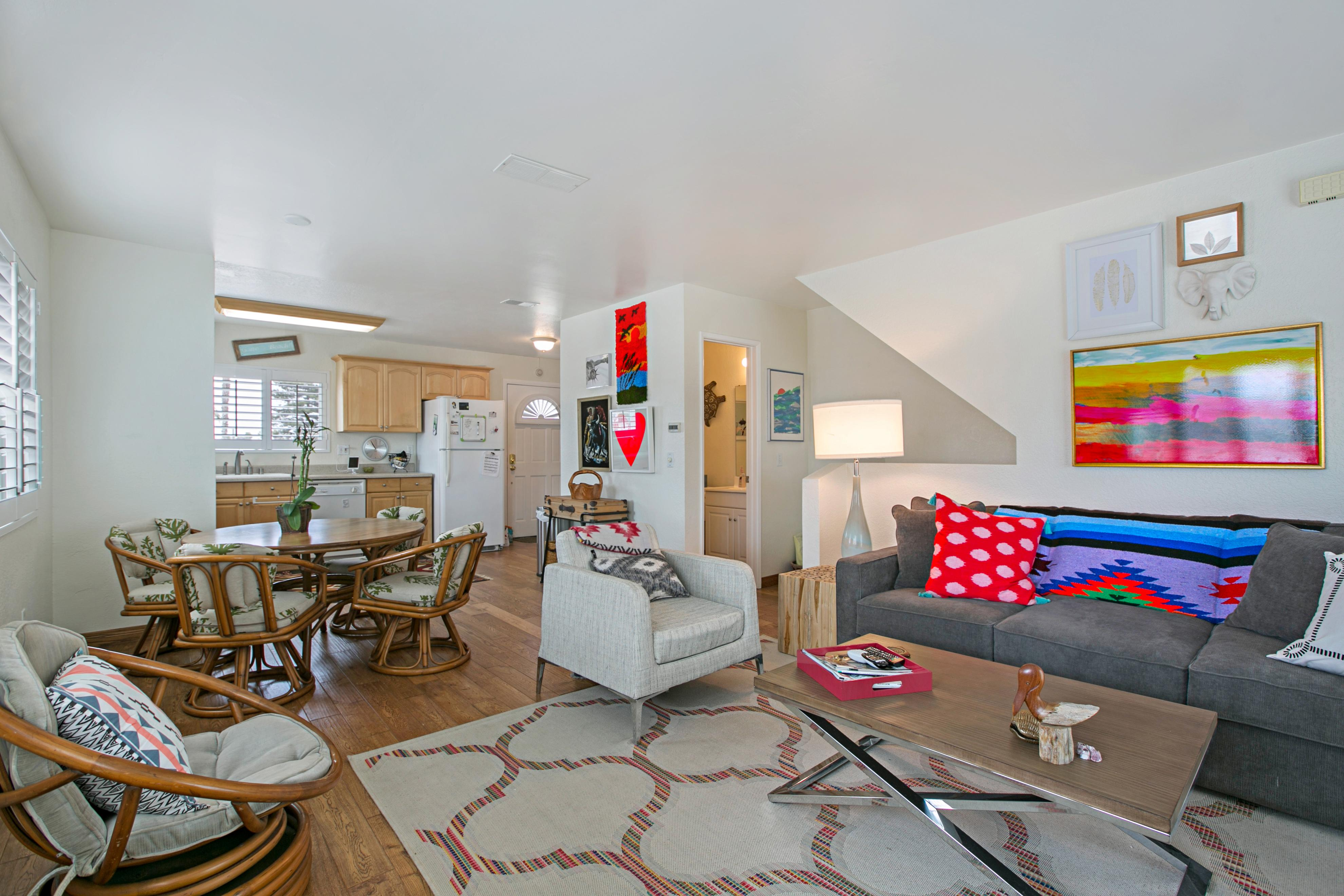 Funky pops of color give the living room true California style.