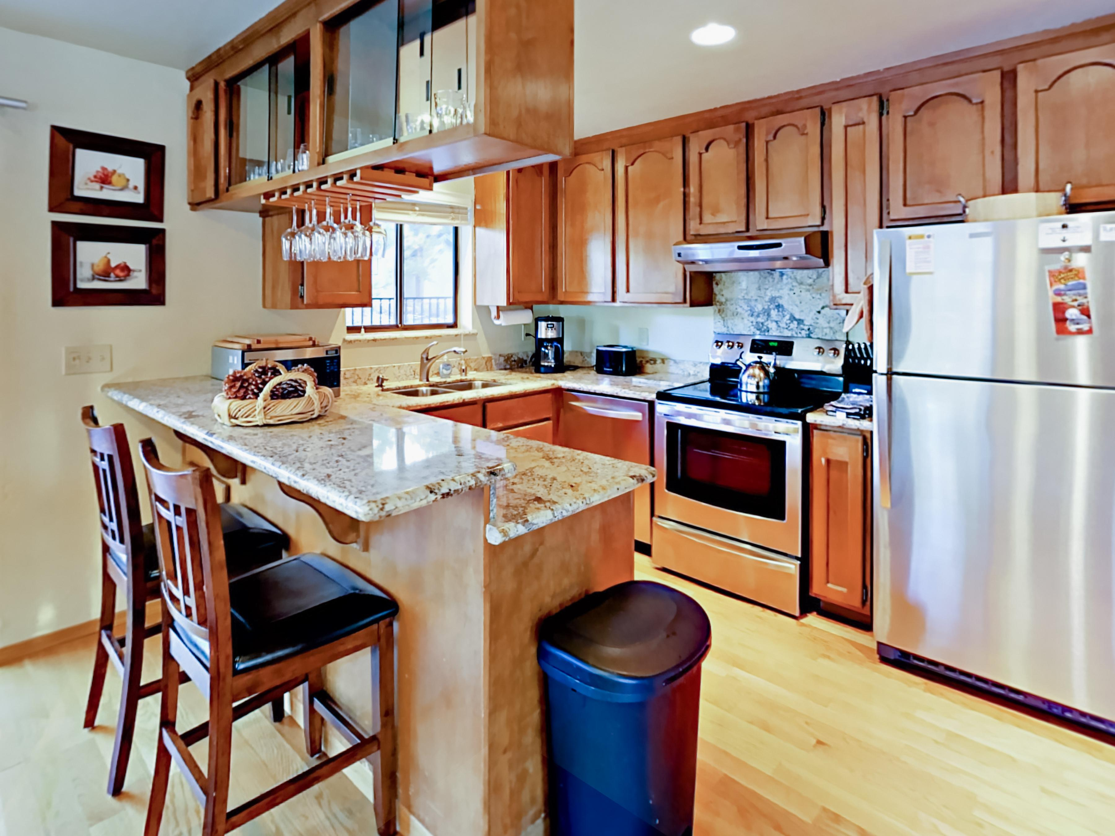 Granite countertops and stainless steel appliances shine in the upstairs kitchen.