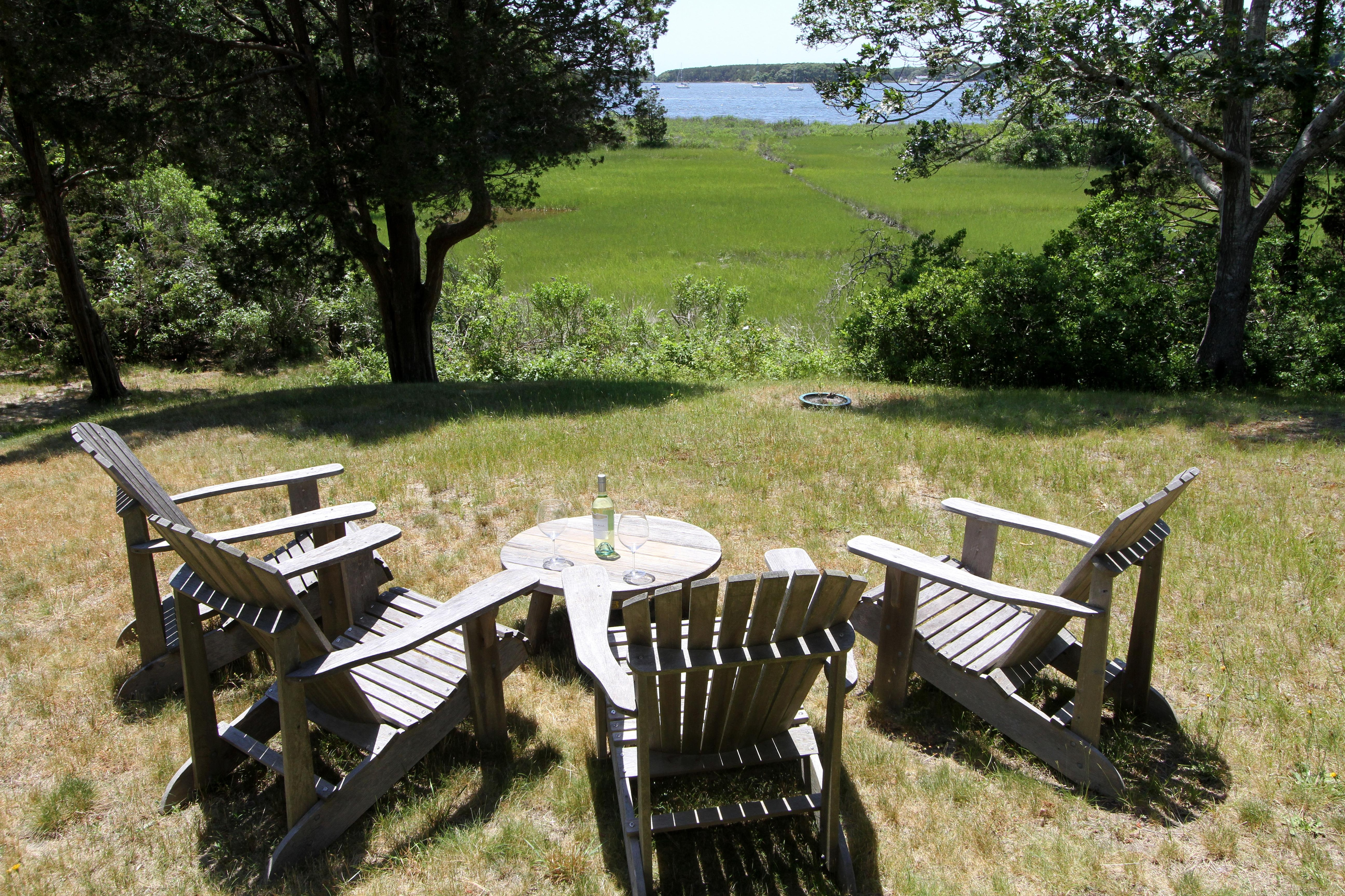 Lounge on the Adirondack chairs in the yard as you overlook Waquoit Bay.