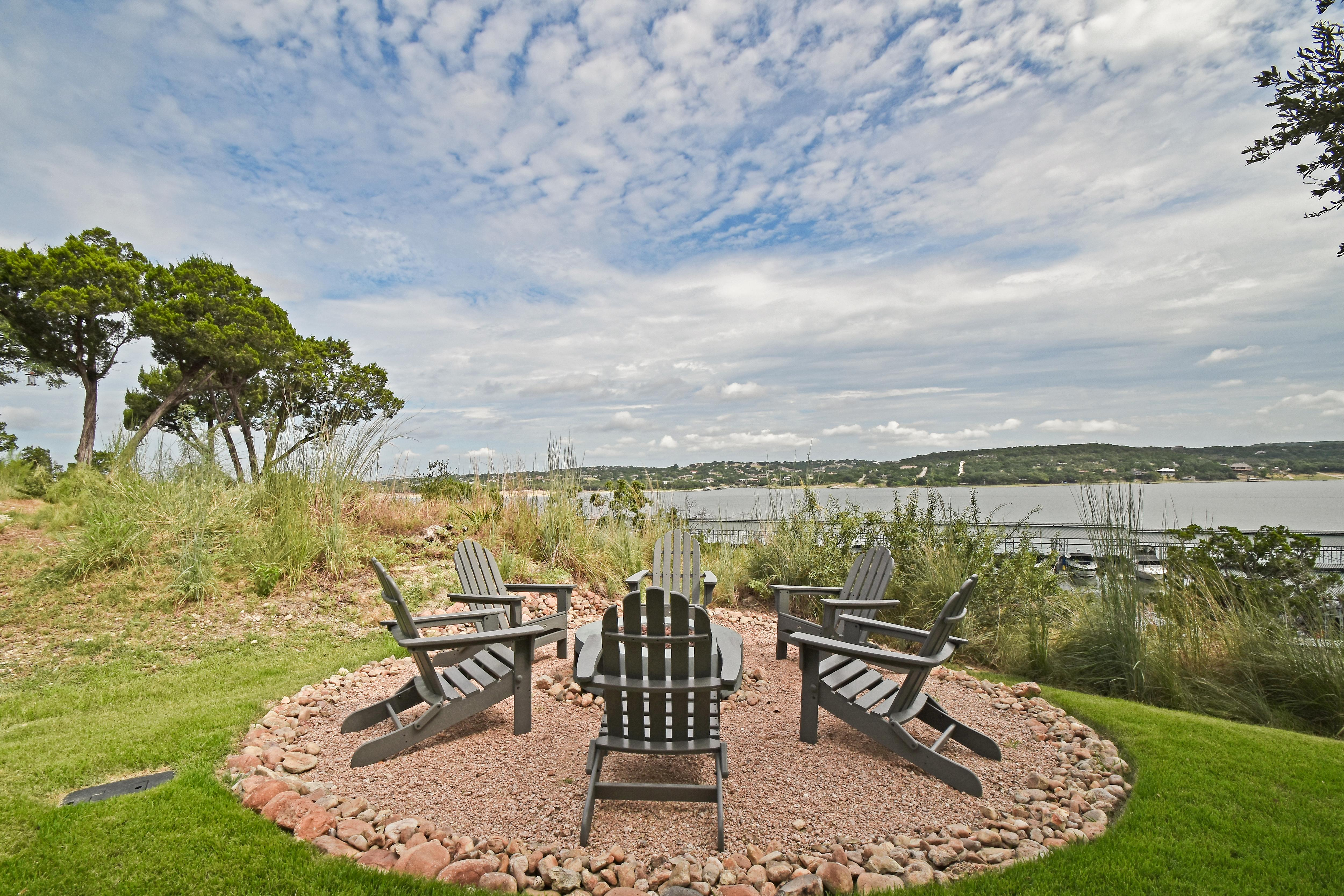 Welcome to Lake Travis! Adirondack chairs face views of The Reserve's marina and lake frontage.
