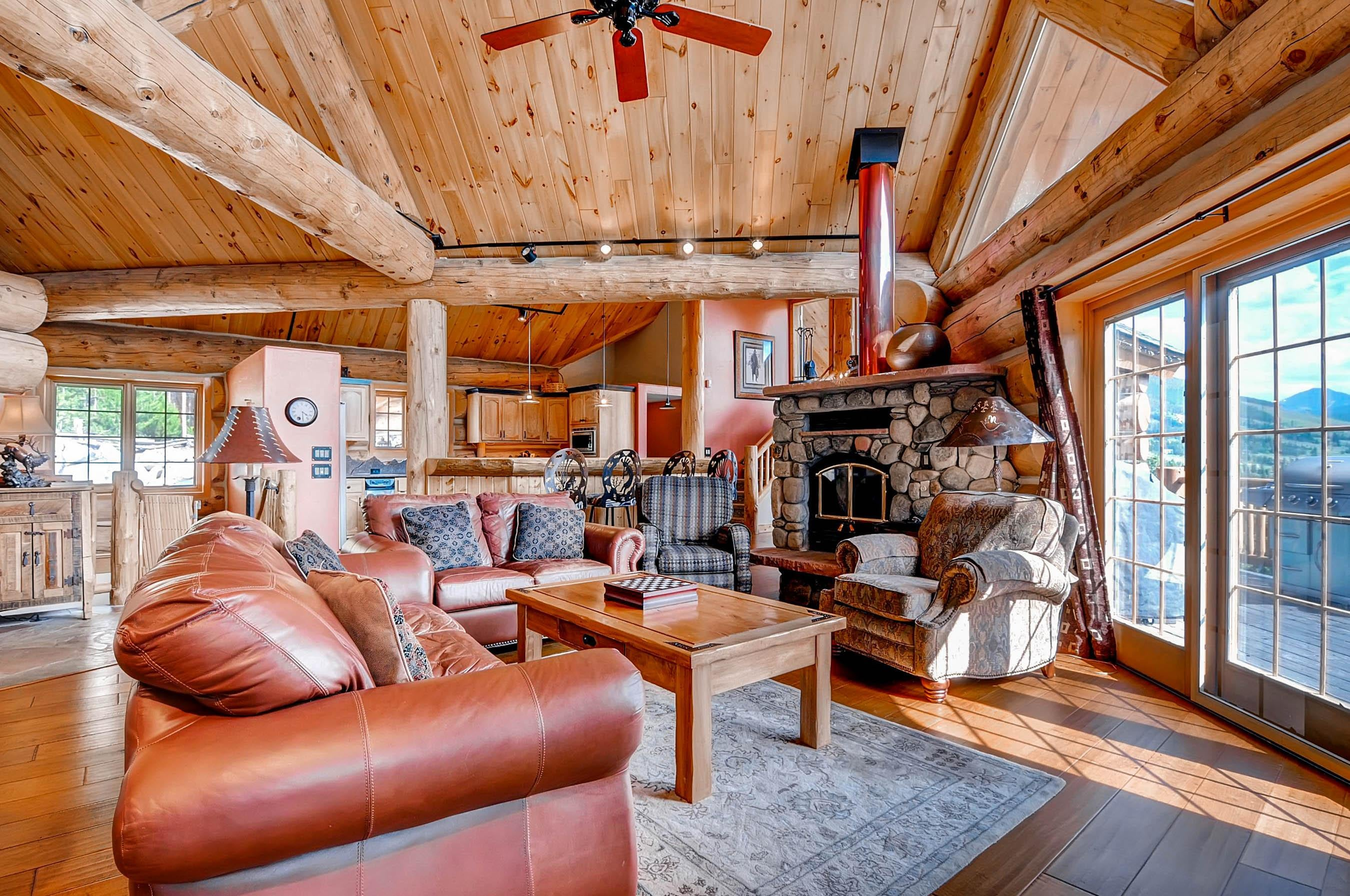 There's seating for 7 before a stone-laid wood stove in the spacious living room.