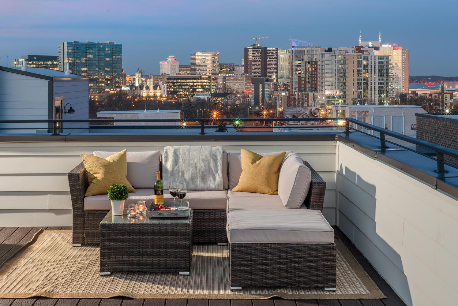 Welcome to Nashville! Take in the Batman building, the Pinnacle building, Stadium, all from your private rooftop deck.