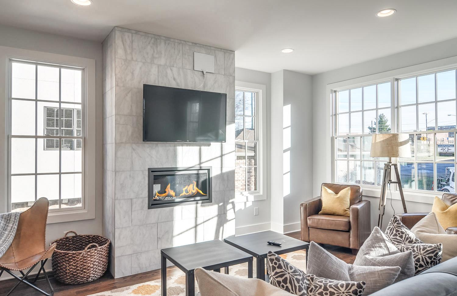 The lovingly decorated living room is a cool hangout in this well-appointed townhome.