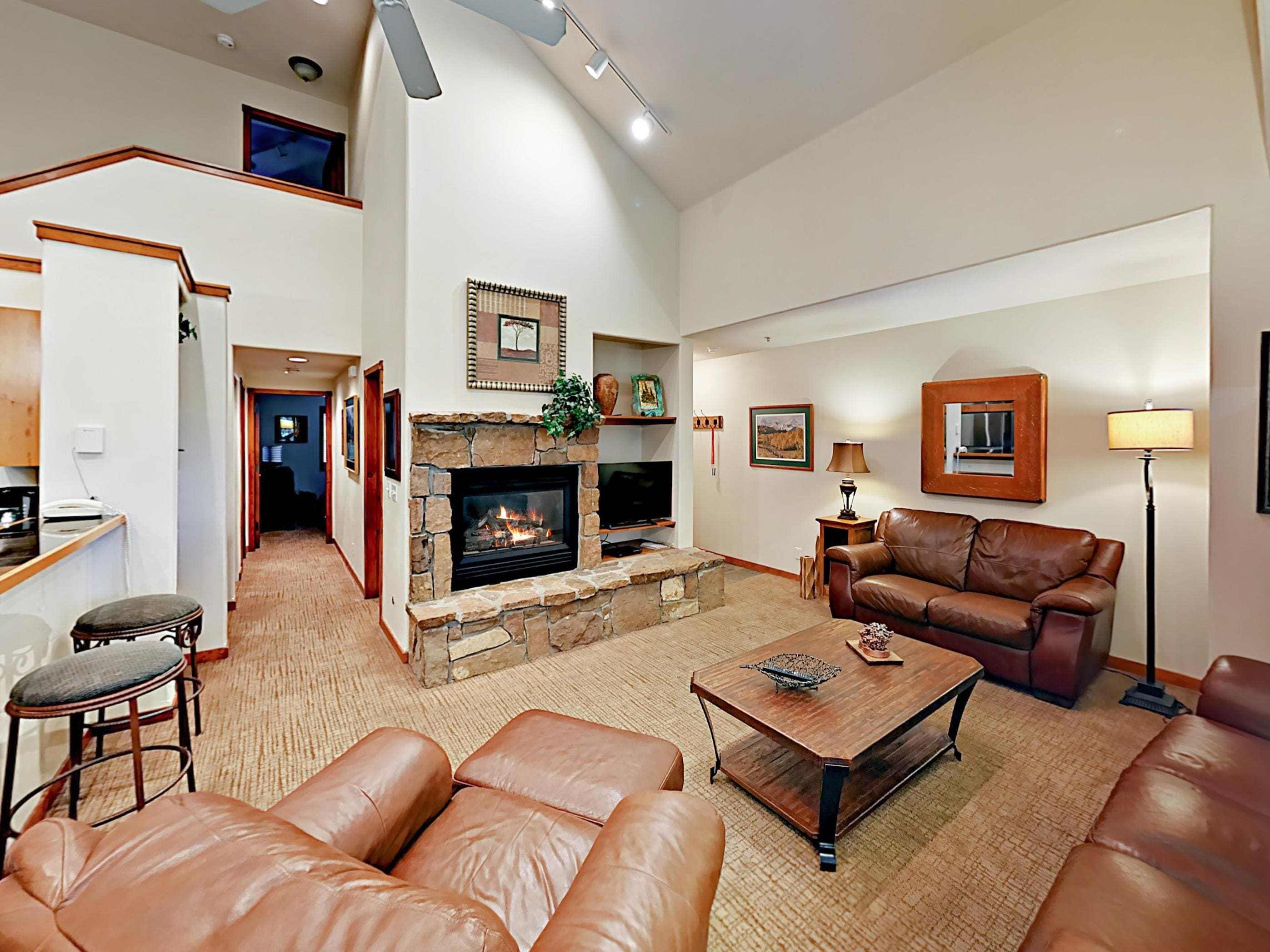 "Kick back in front of a 40"" Smart TV and a large stone fireplace for movie nights."