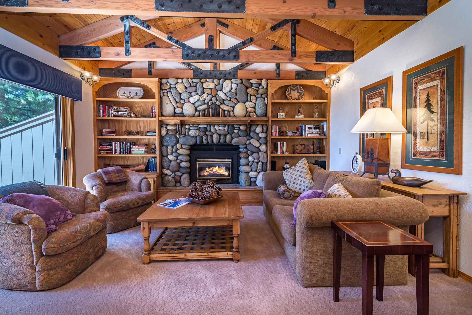 The cozy cabin-style living room invites you to snuggle up with a book.