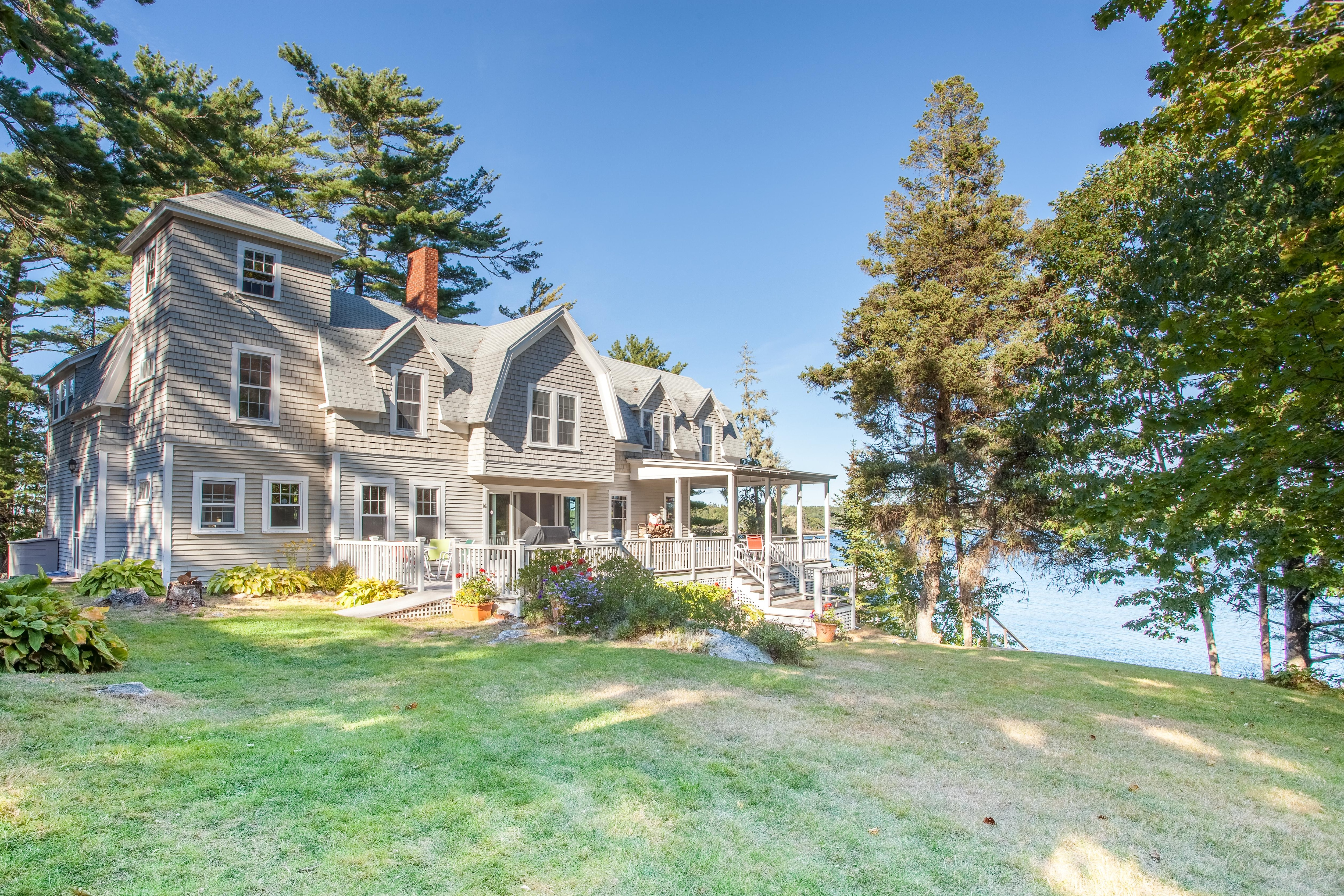 Welcome to Boothbay Harbor! This stately Maine cottage is ideal for family reunions.