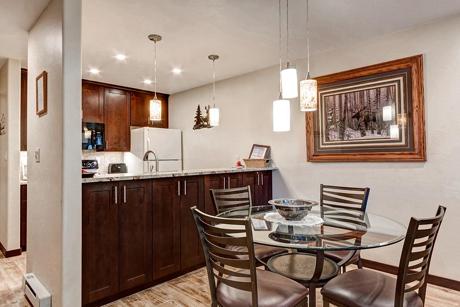 The kitchen overlooks the dining area for convenience.