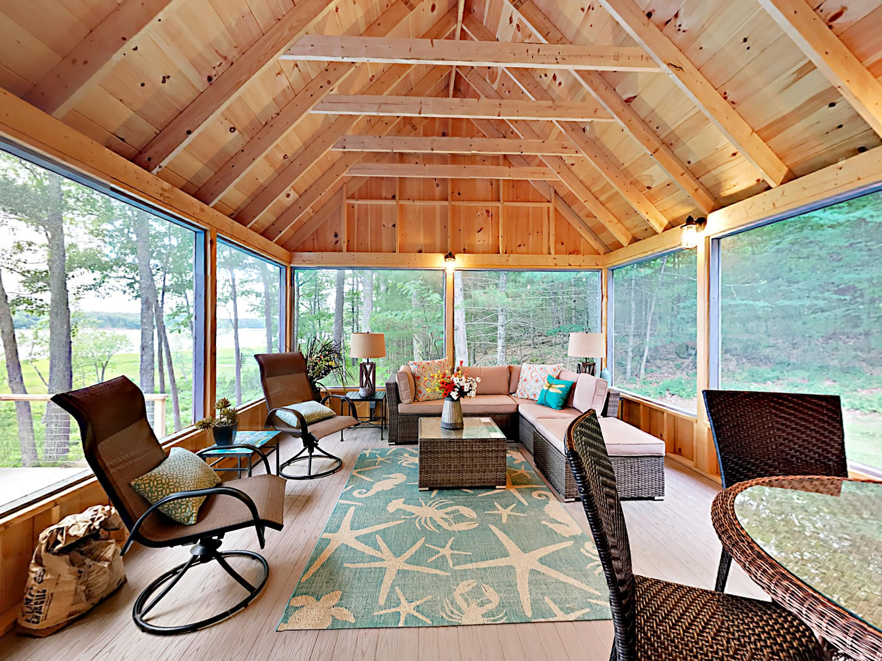 Lounge or enjoy dinner in the screened-in porch.
