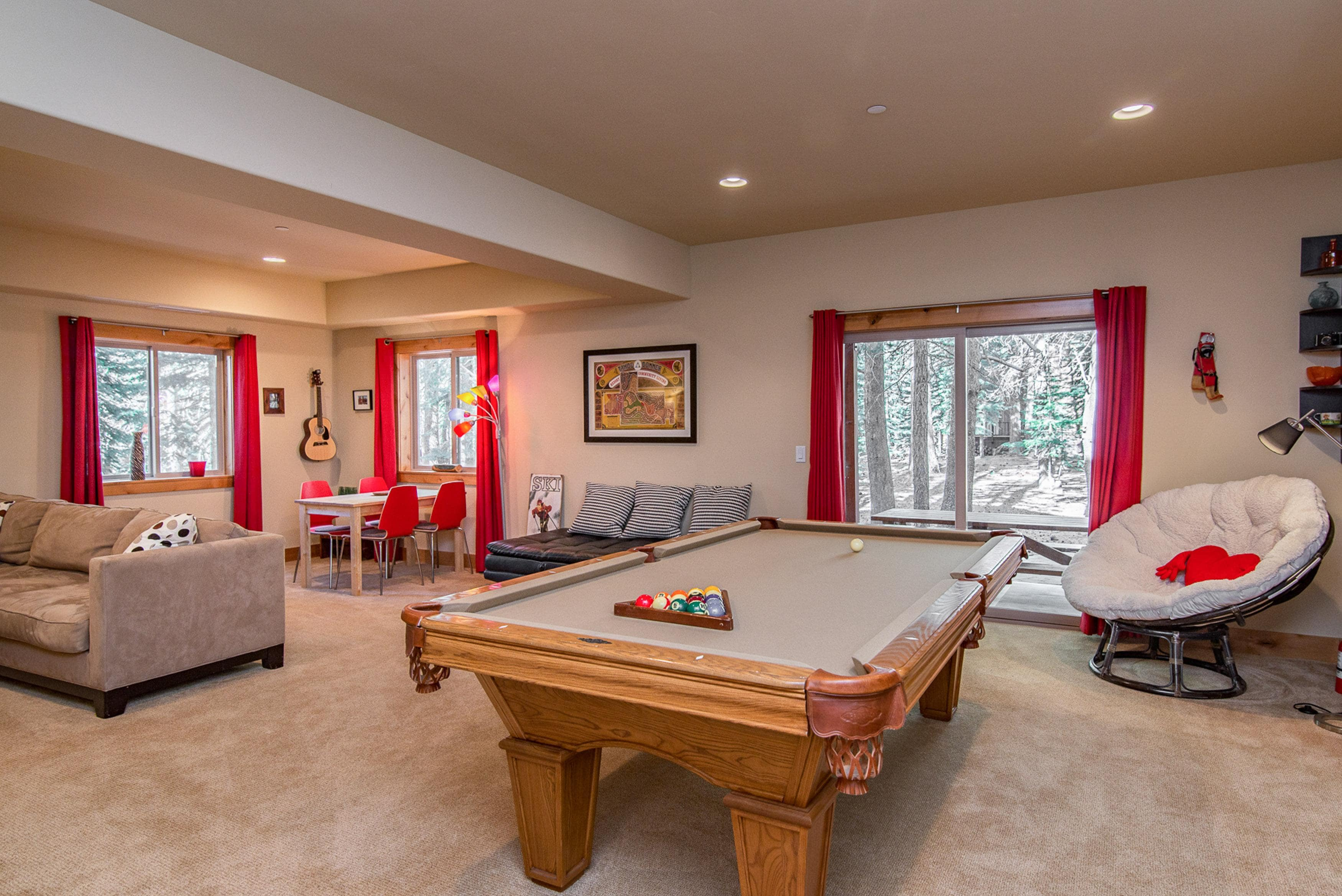 The cozy game room has plenty of seating and access to the backyard
