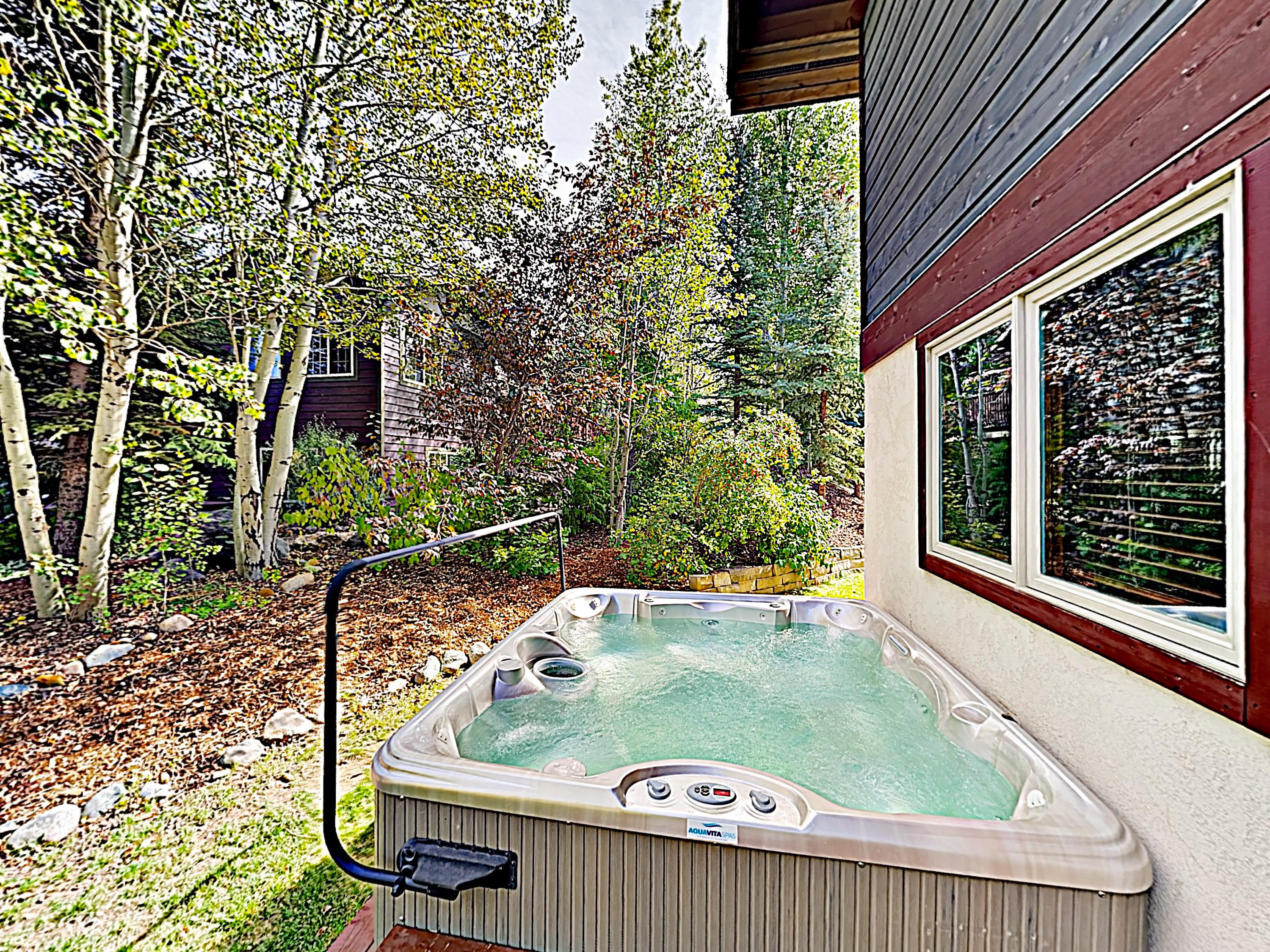 Soak in the private hot tub after a fun-filled day of adventures.