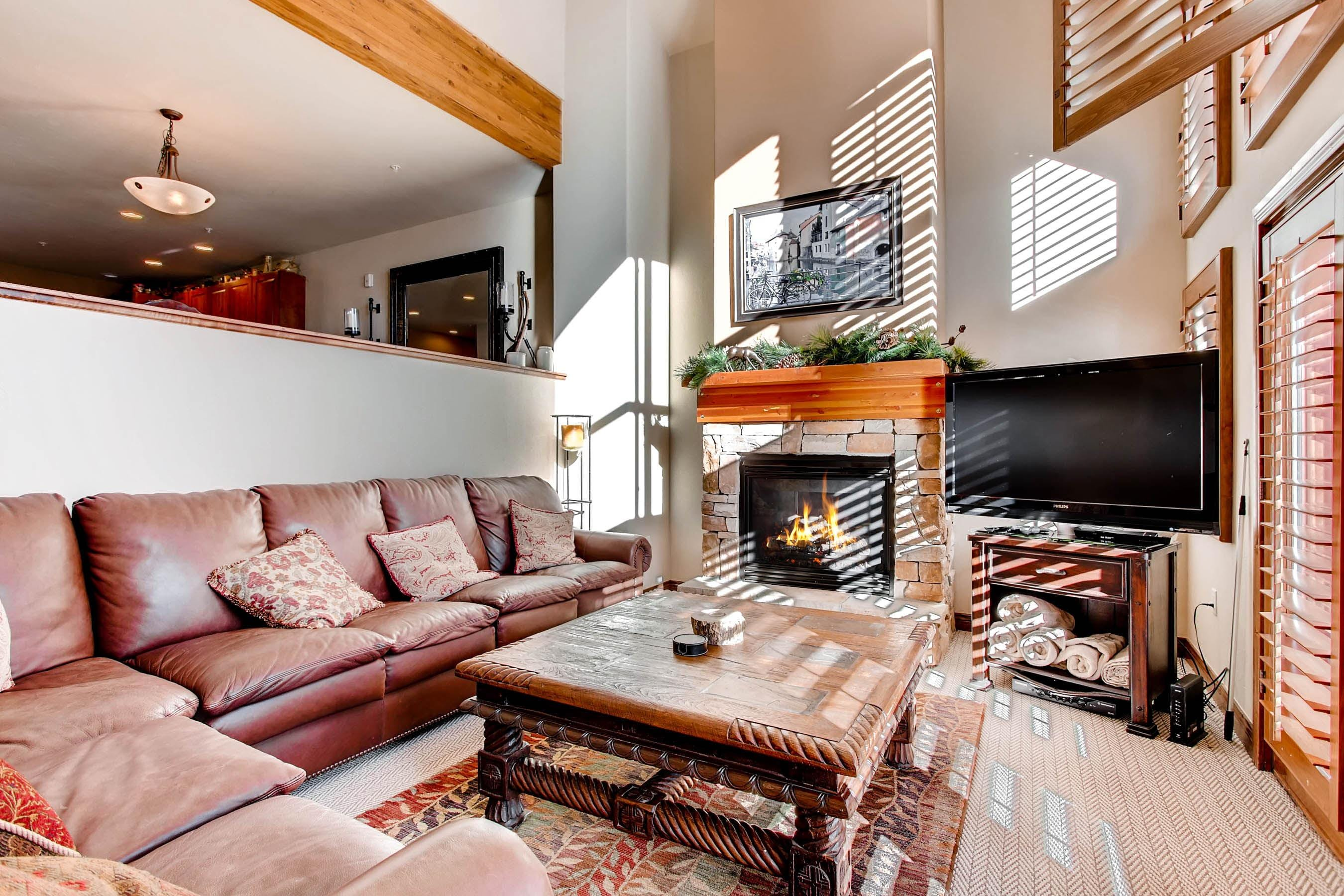 When the snow is blowing, gather in the cozy sunken living room with a fire blazing in the stone fireplace