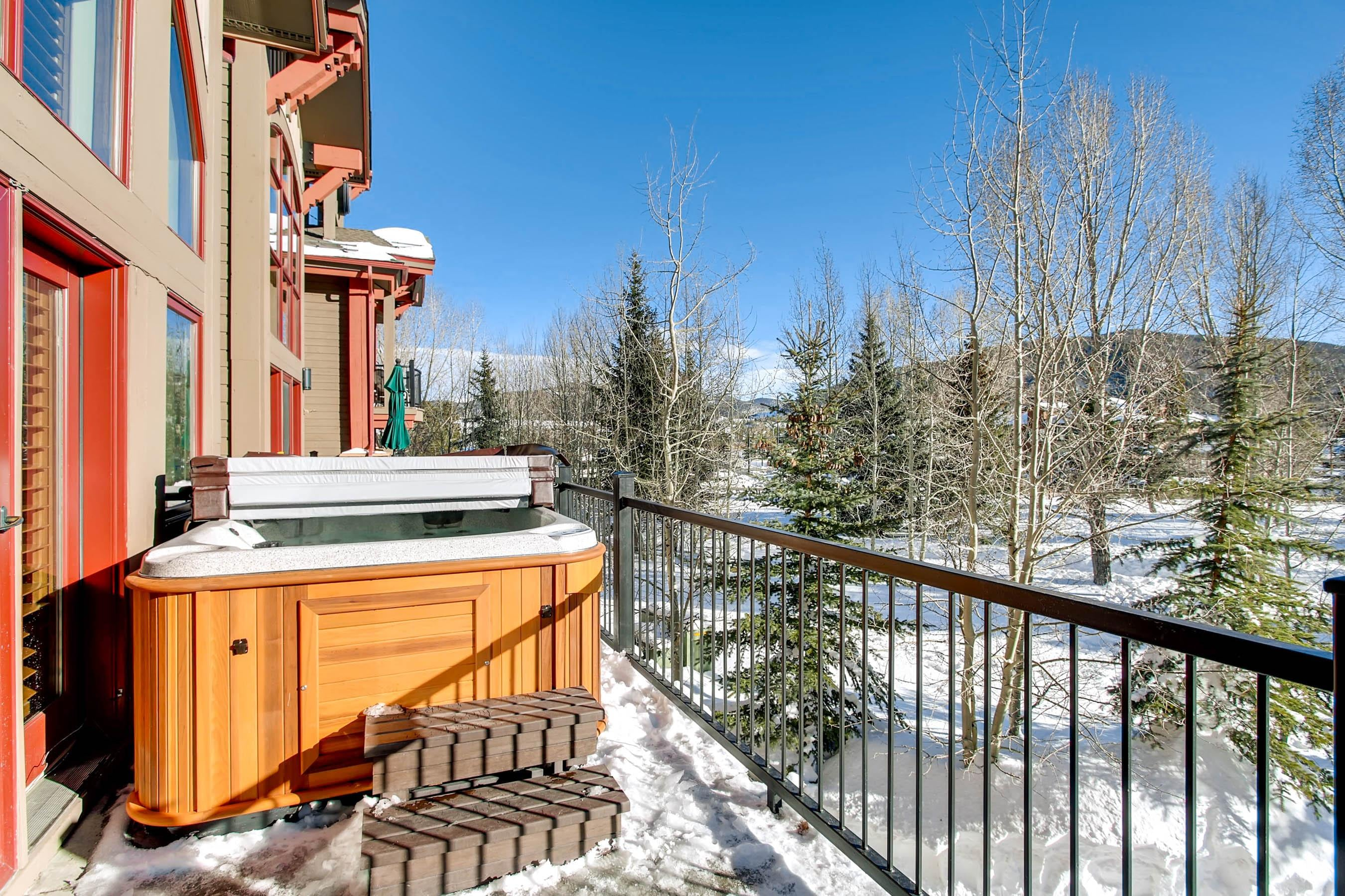 A private balcony houses a hot tub just off the living room, where you can enjoy bubbling water and mountain views