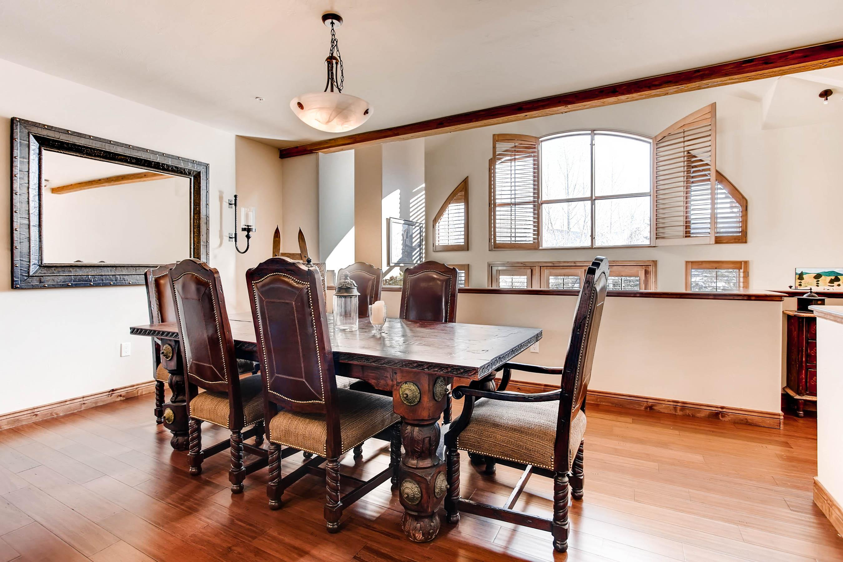 Next to the kitchen, a dining area offers a solid wood 6-person table perfect for meals and good conversation