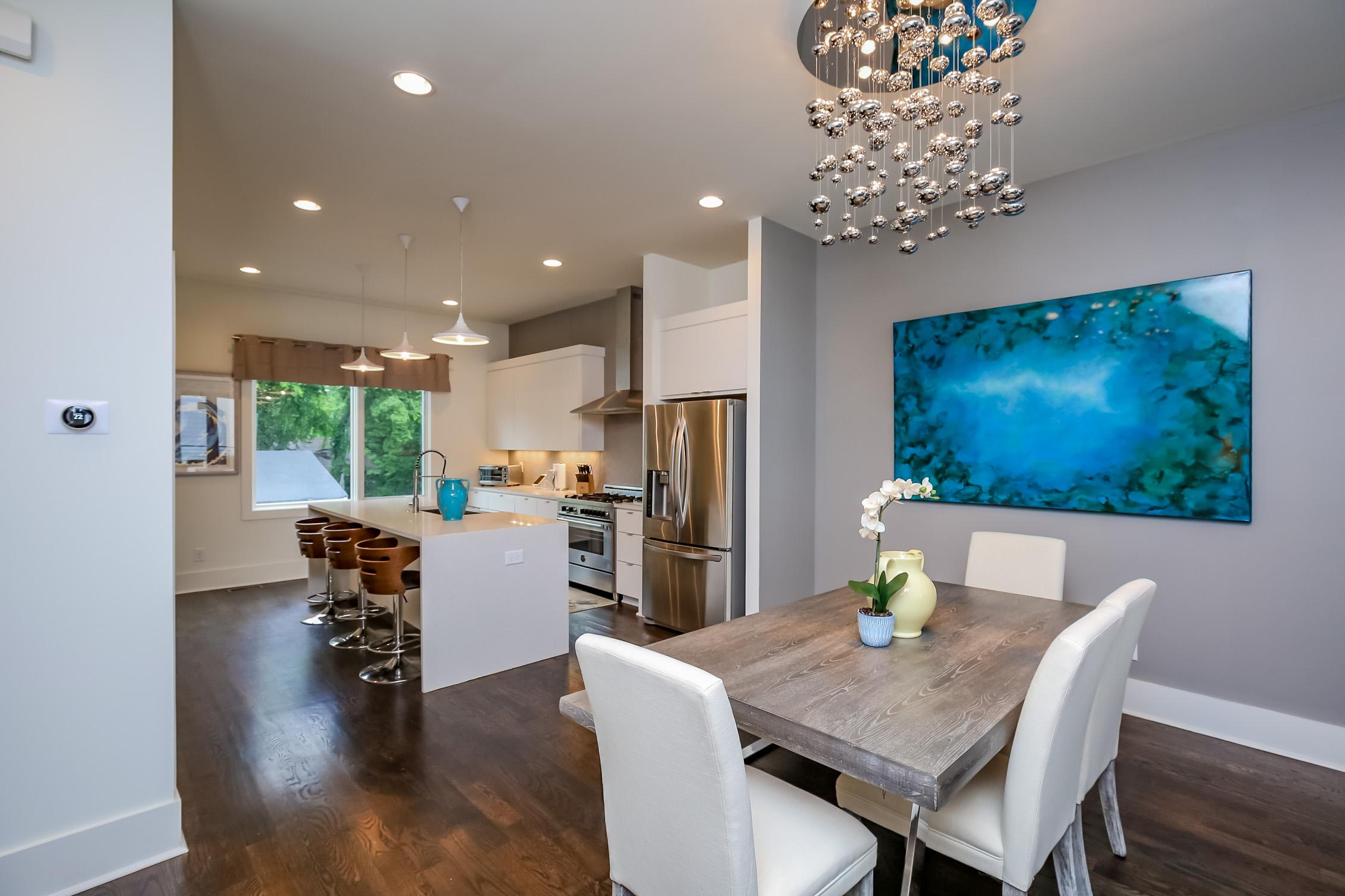 The chic dining space is open to the kitchen.
