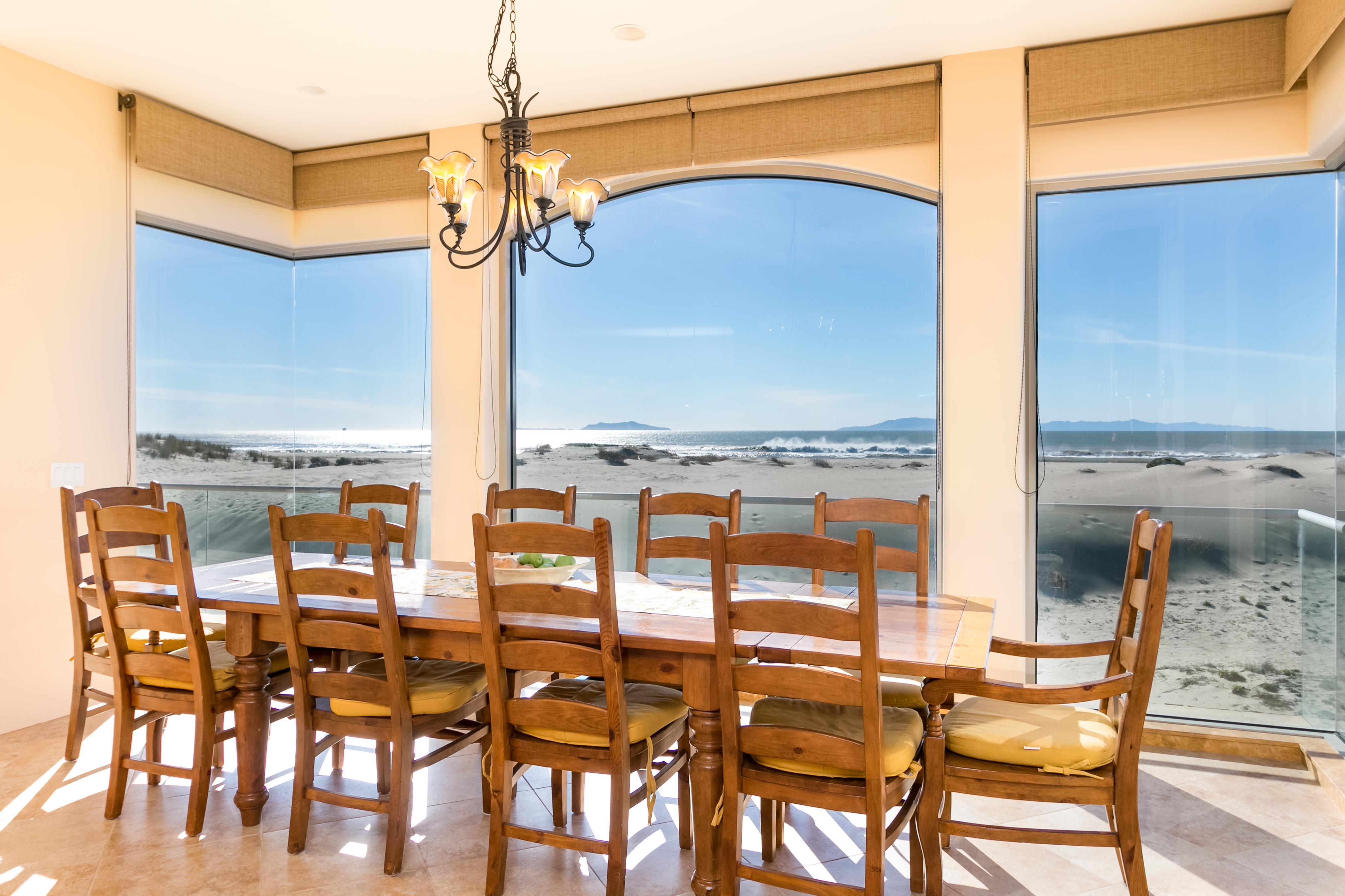 The dining area seats 10, with a sweeping outlook of the beach and North Pacific Ocean.