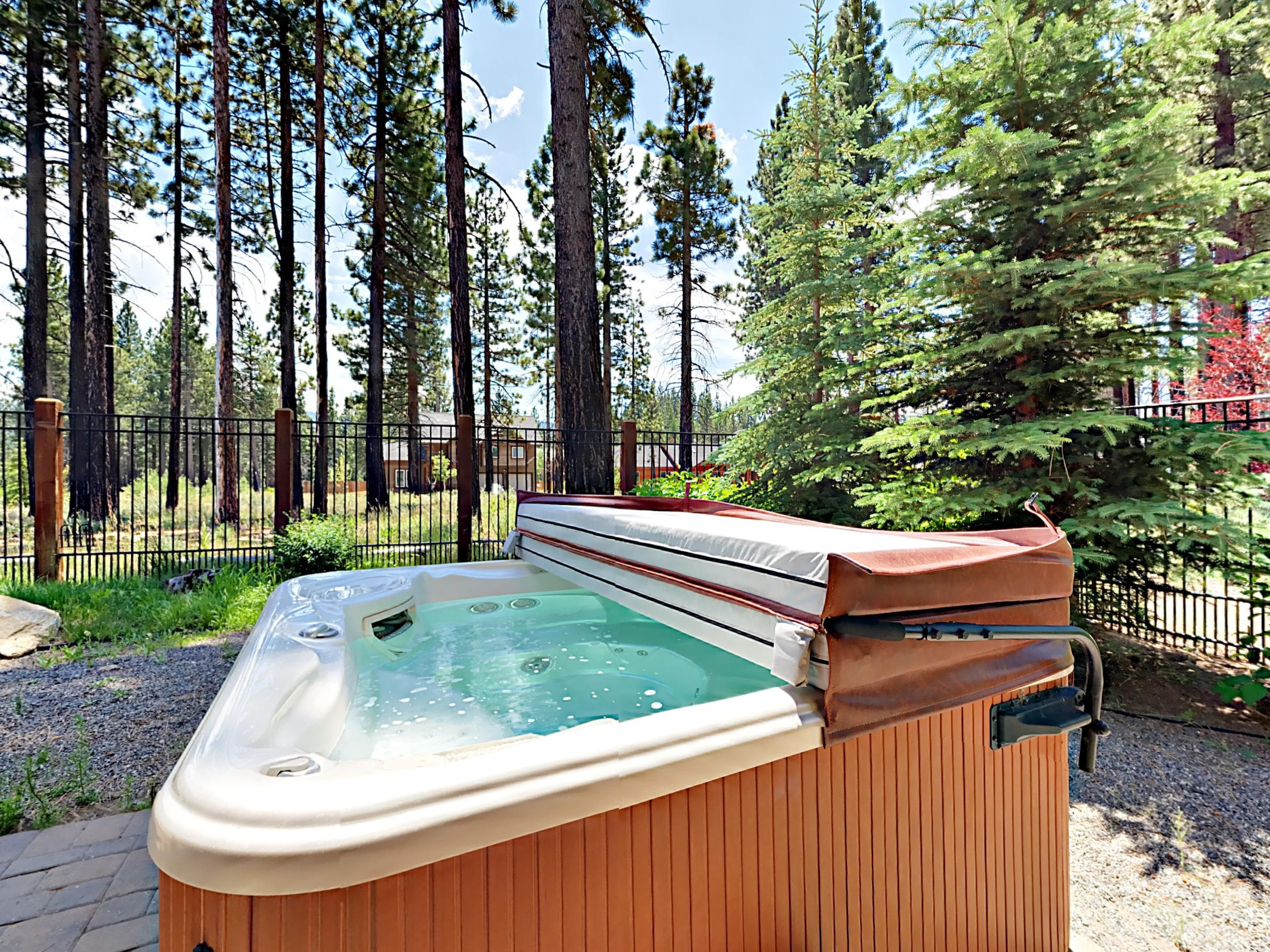 An oversized hot tub provides the perfect space to unwind.