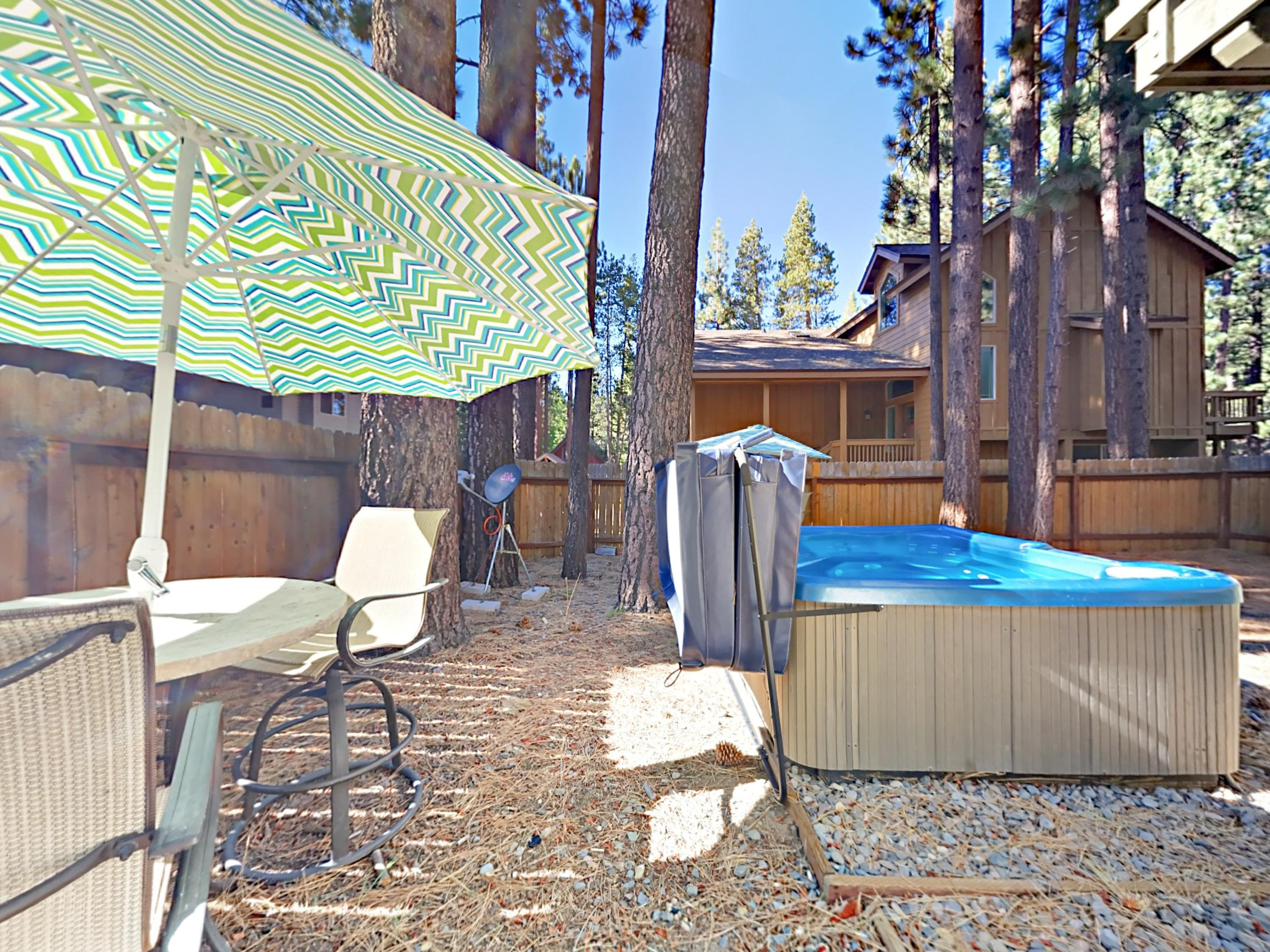 Unwind in the backyard hot tub or at the shaded patio table.