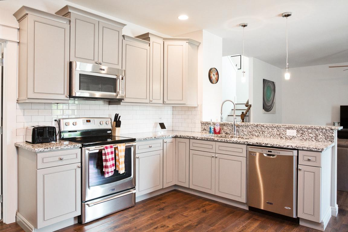 Subway tiles and stainless steel appliances adorn the kitchen.
