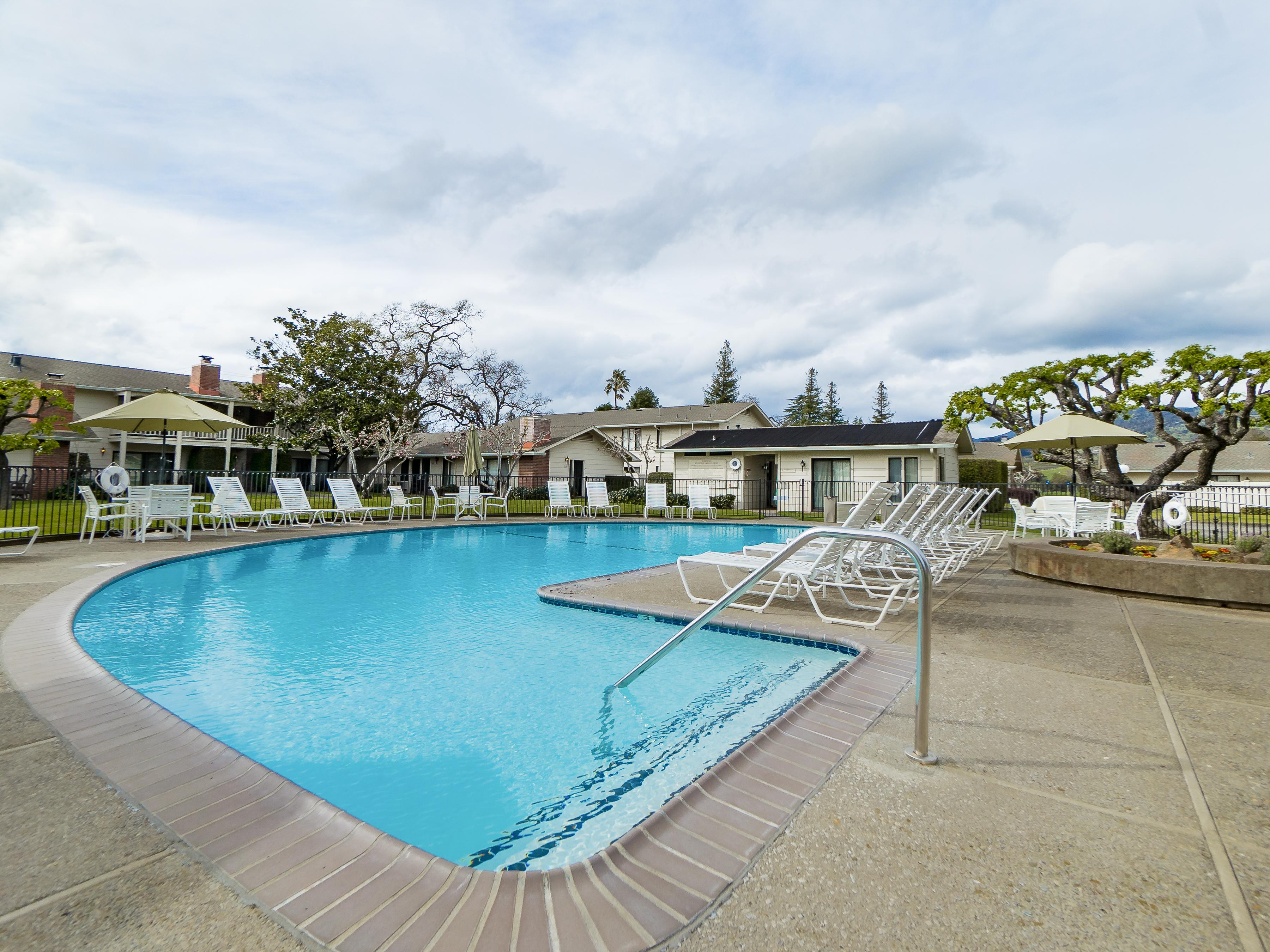 The shared community pool is a quick walk from your rental.