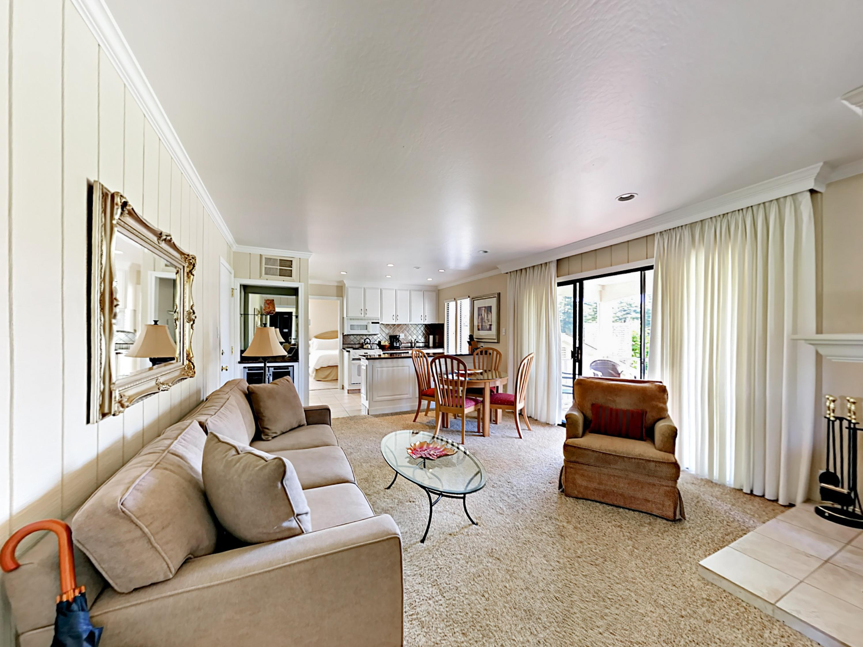 Welcome to Napa! The living room offers easy access to the private balcony overlooking the golf course.