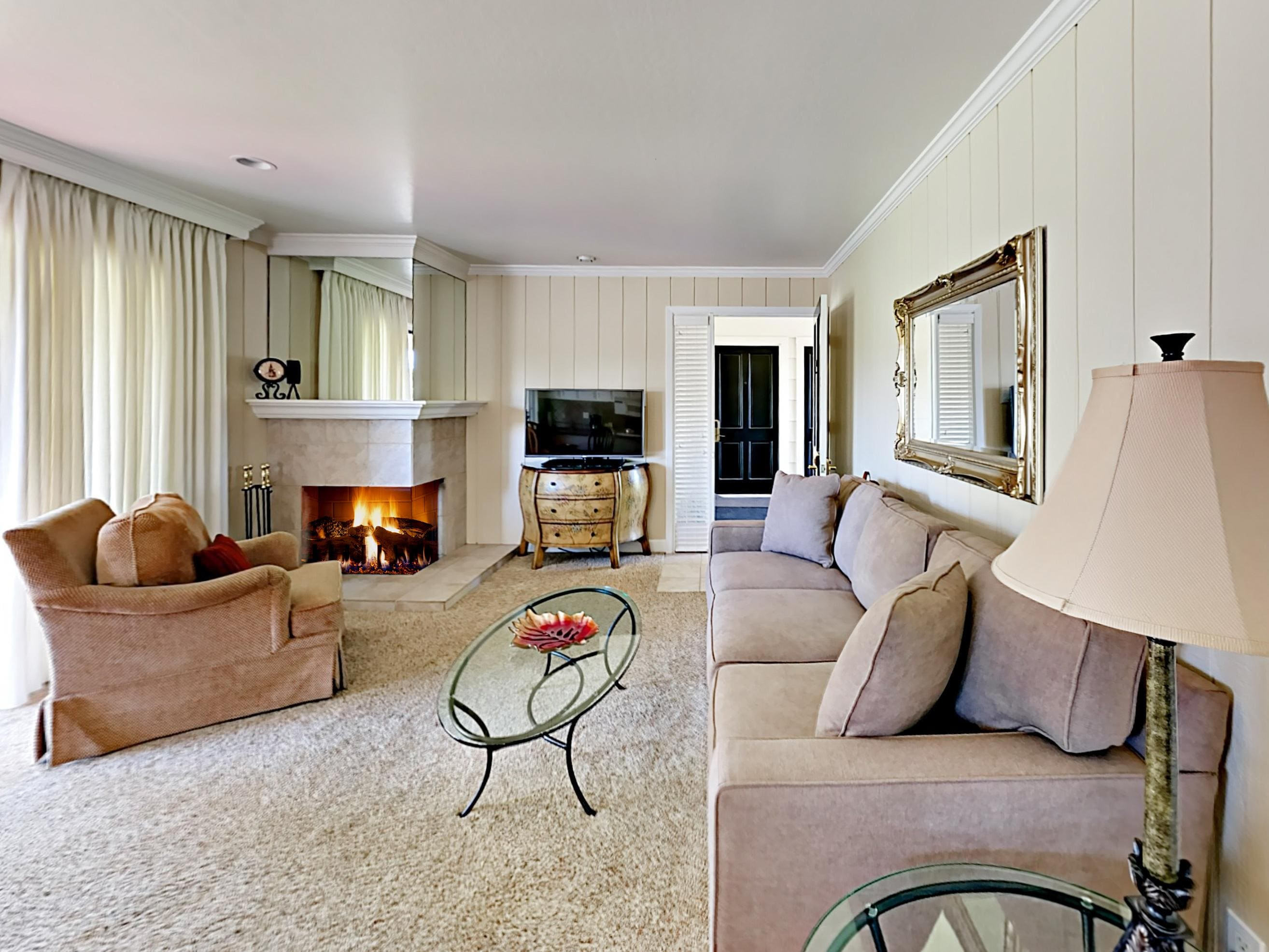 Welcome to Napa Valley! Relax on a sofa and armchair while the fireplace warms the space.