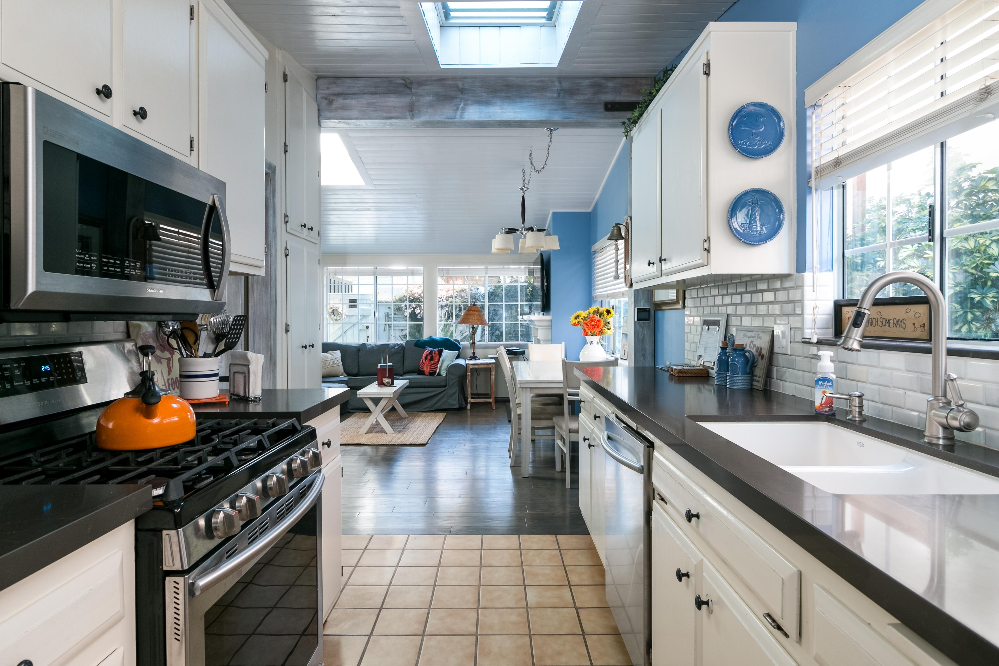 White tile backsplash adds to a fresh vibe in the kitchen.