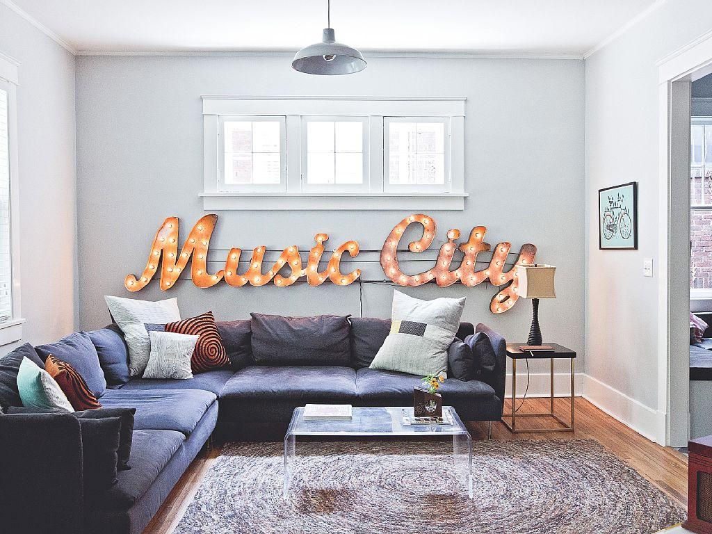 "Living Room – You'll feel like a star with the bright ""Music City"" sign shining behind you in this decidedly artsy rental"