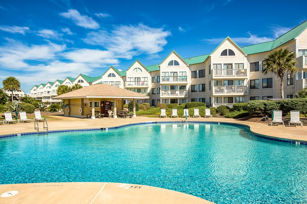Classic Resort Setting Condo That is Steps to the Beach