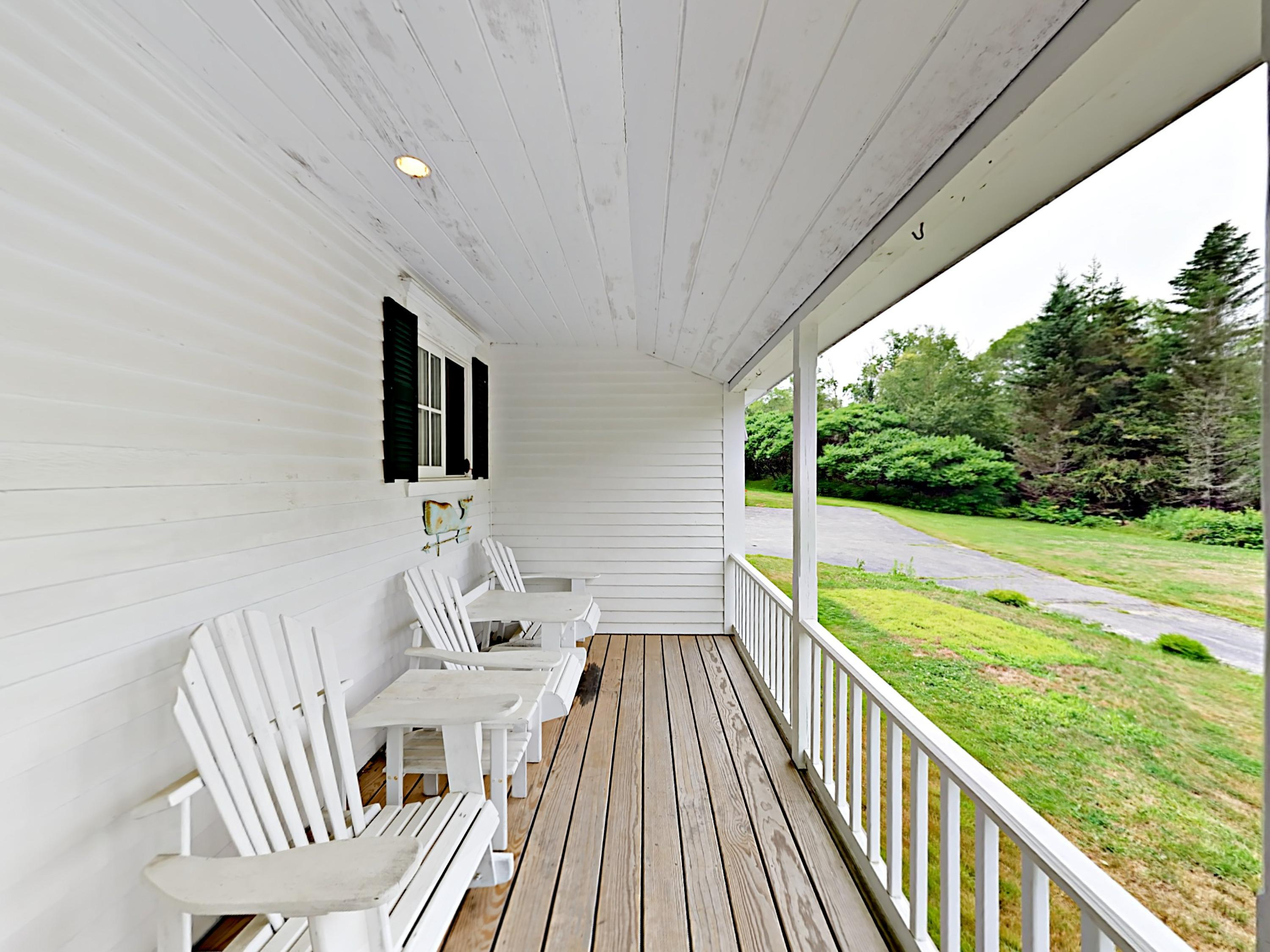 The expansive, wraparound porch provides ample seating.