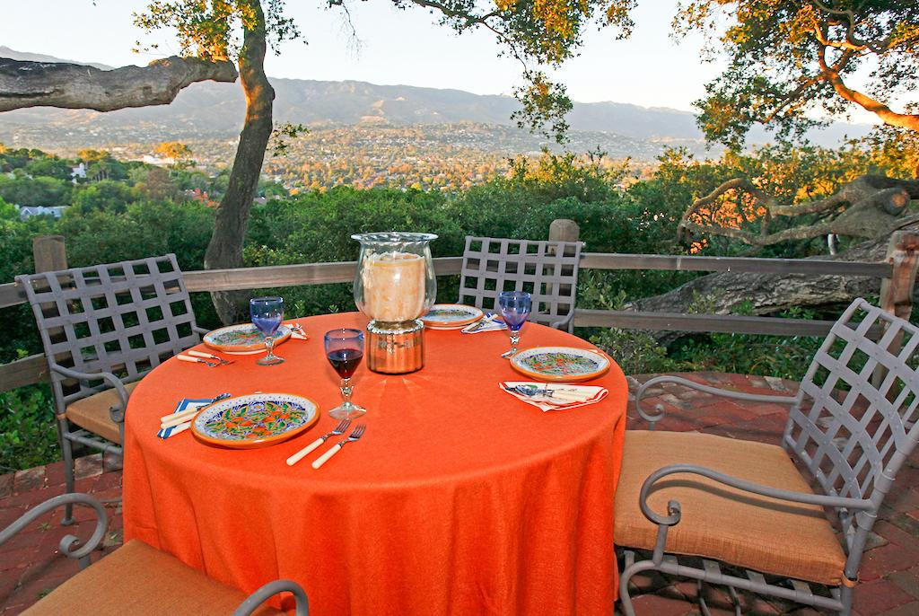 The terrace offers outdoor dining paired with an incredible vantage point of the mountains and city.
