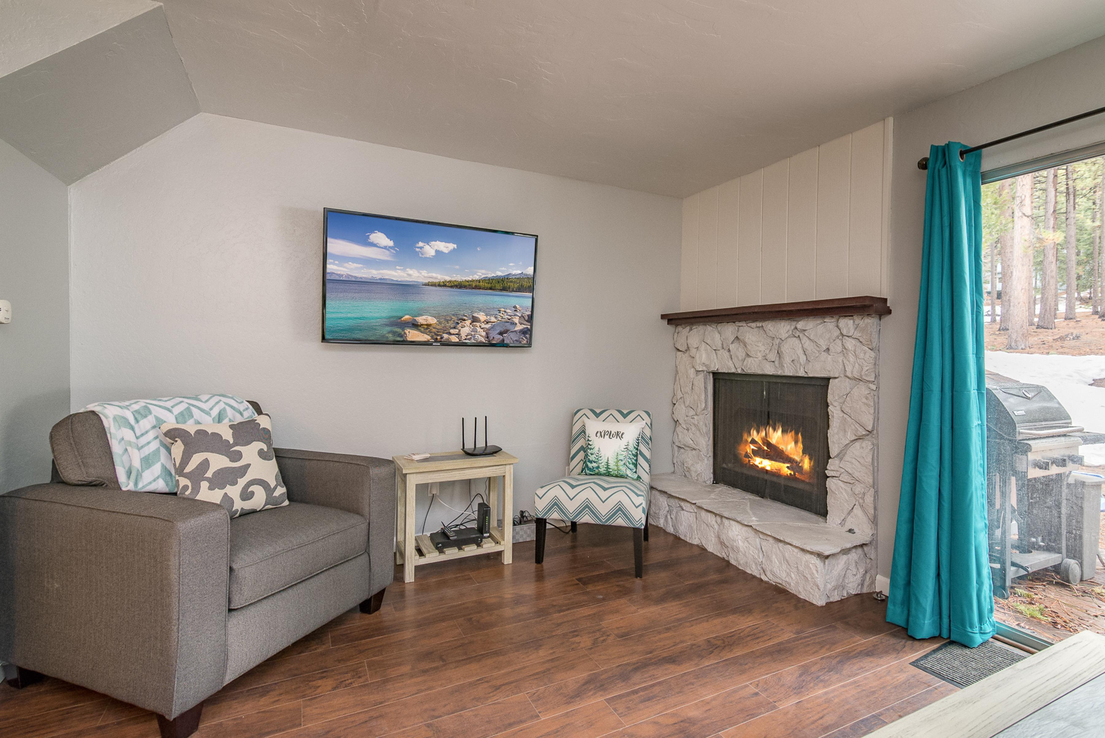 The gas fireplace creates a cozy ambience in the living room.