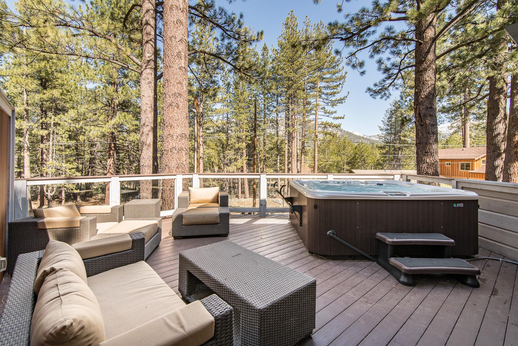 There's plenty of patio furniture for fresh air hangs, along with a hot tub.