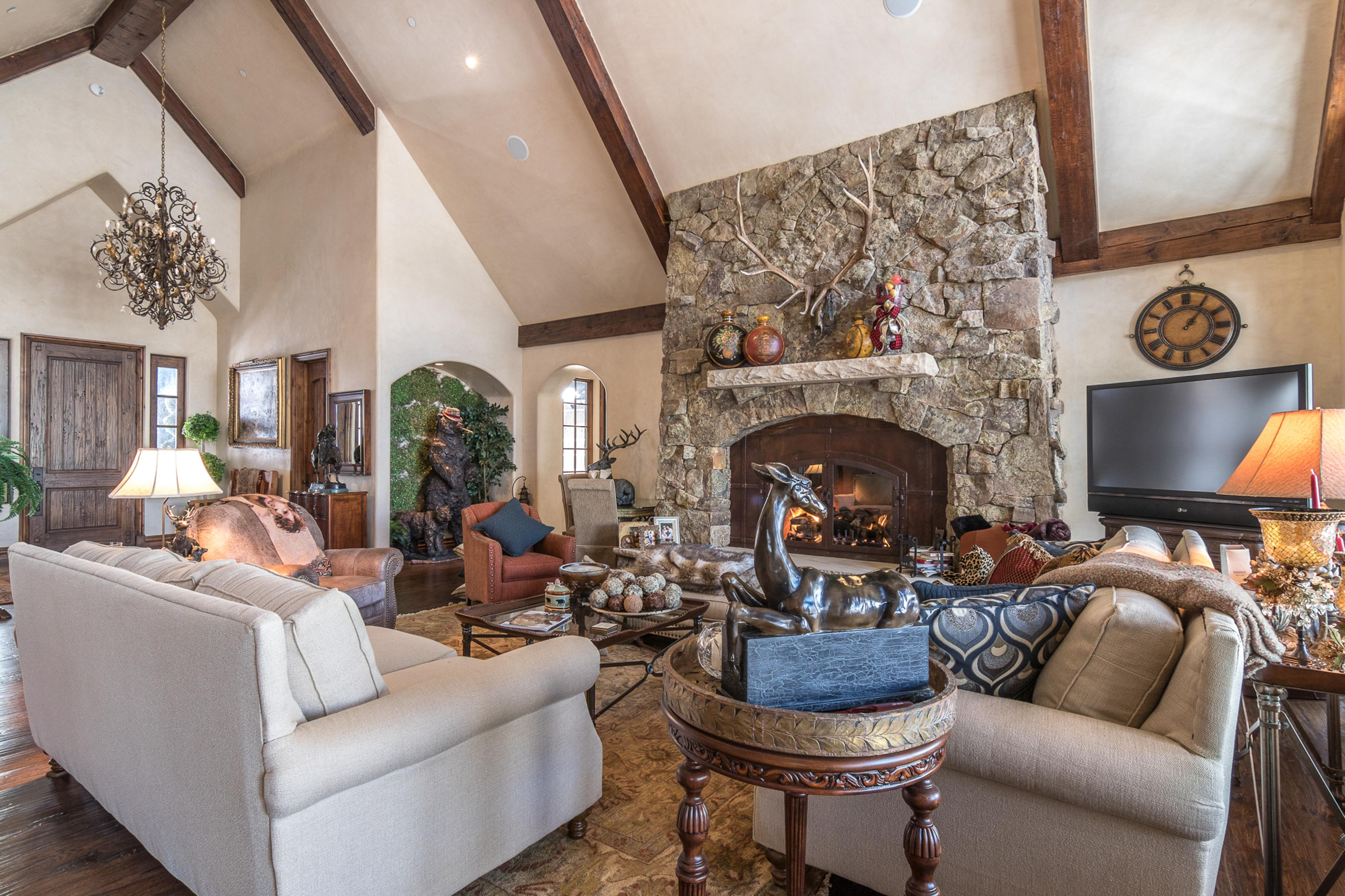 "Vaulted ceilings, a stone fireplace and 52"" flat-screen TV are featured in the grand living room."