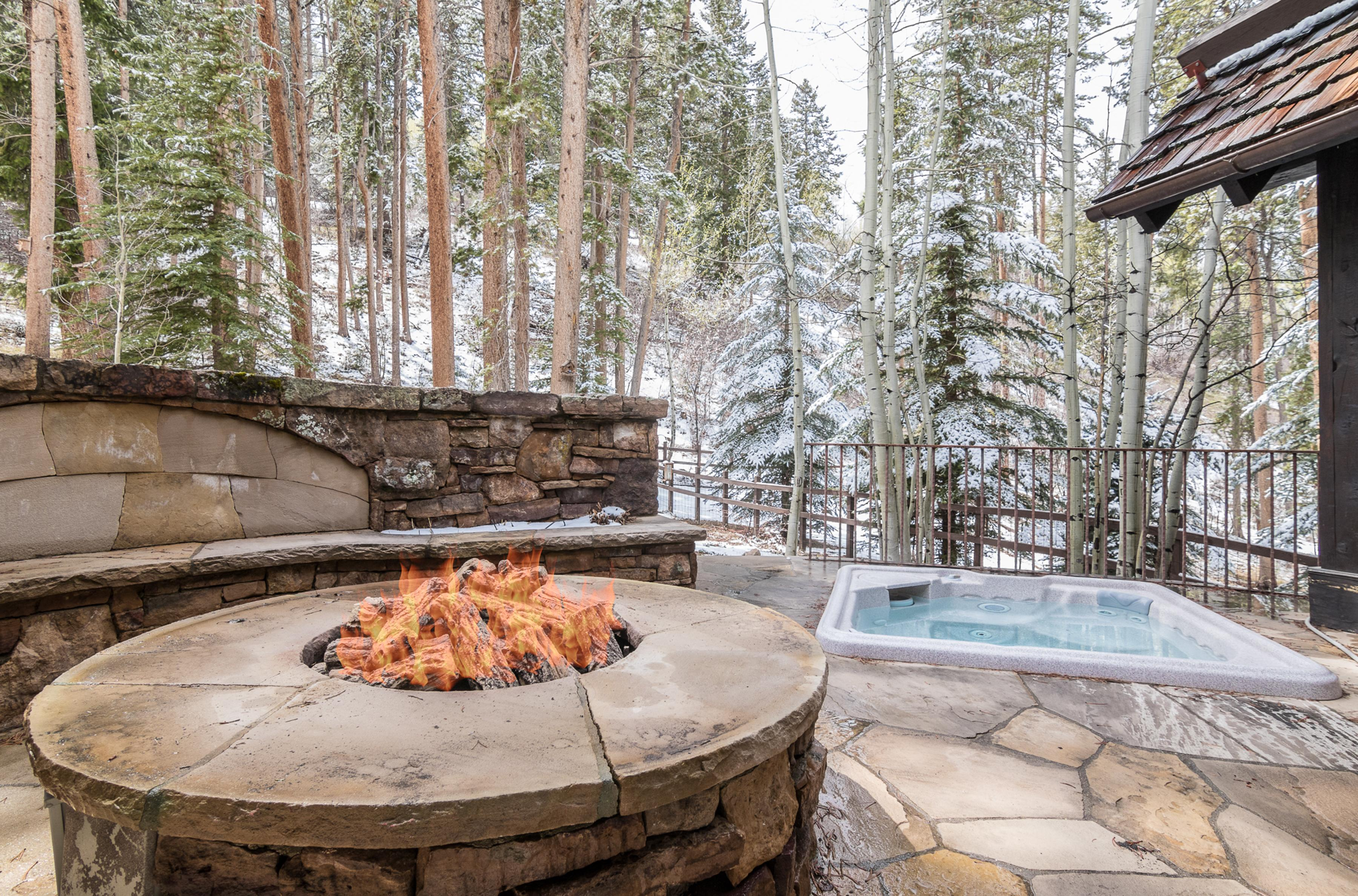 Huddle around the fire pit or take a soak in the hot tub on the patio.
