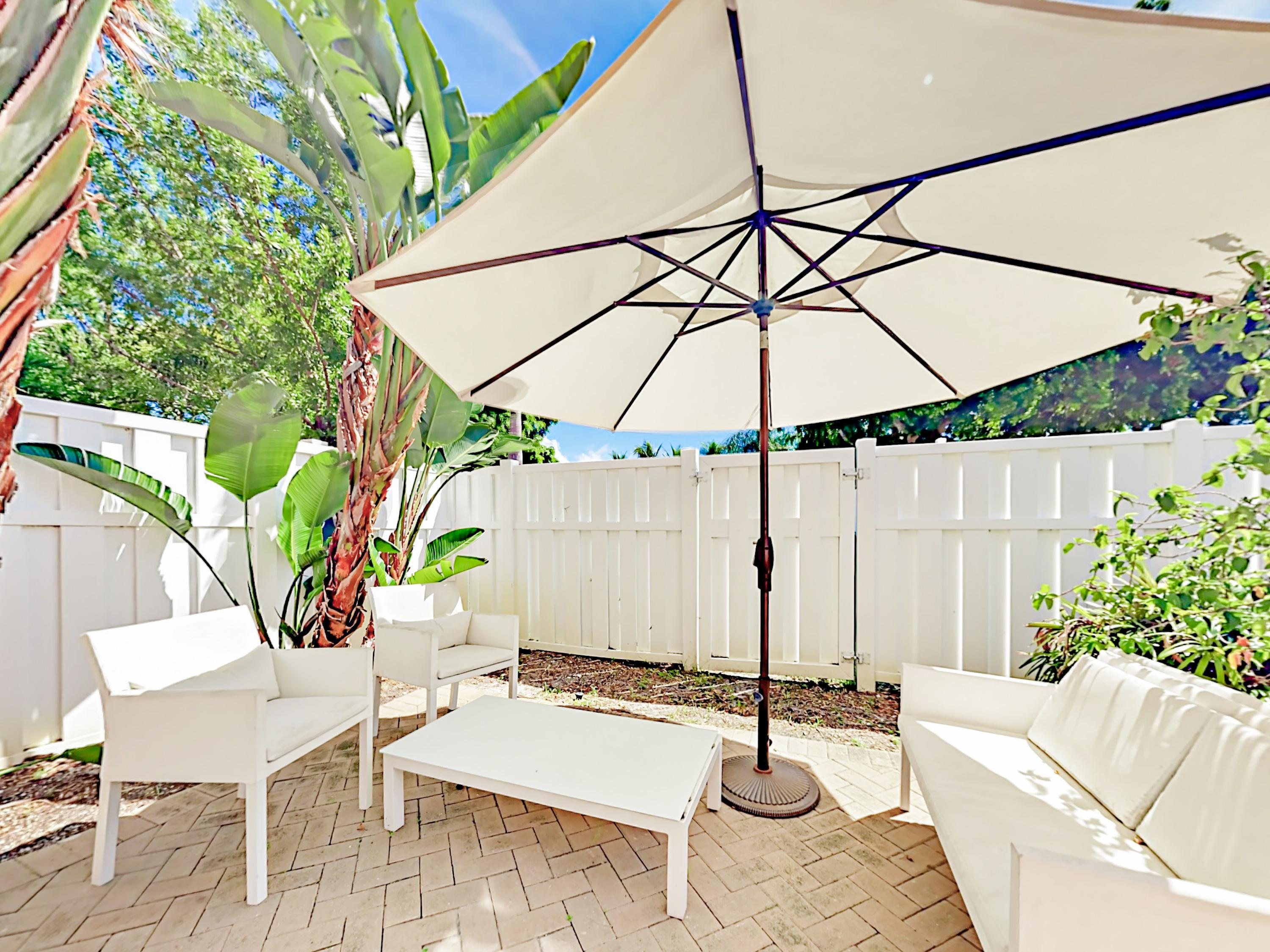 Enjoy cool drinks and conversation underneath a shady patio umbrella.