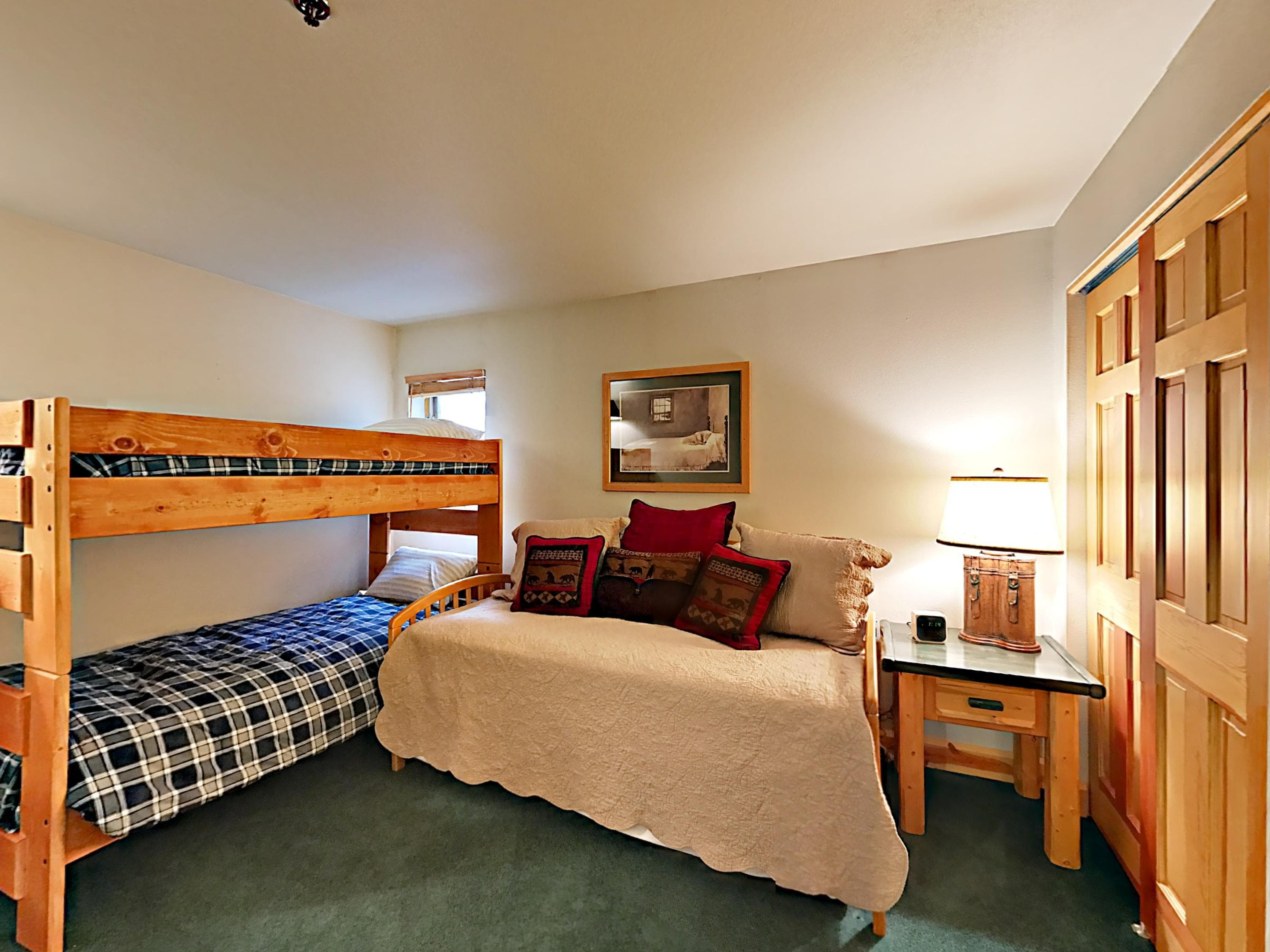 Located on the entry level, the second bedroom has a twin-over-twin bunk and twin trundle.