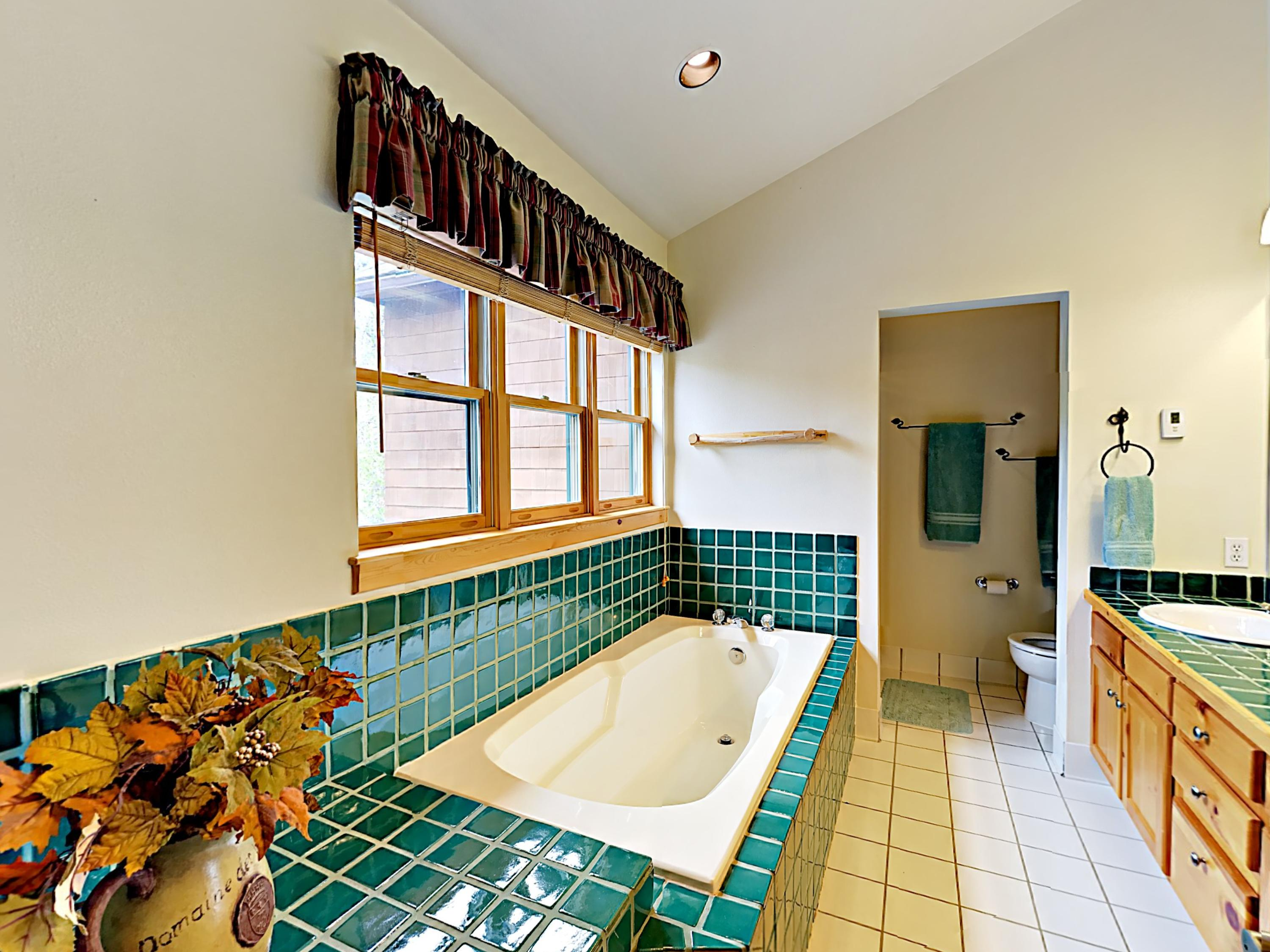 The en suite master has a sunken tub for prime relaxation.