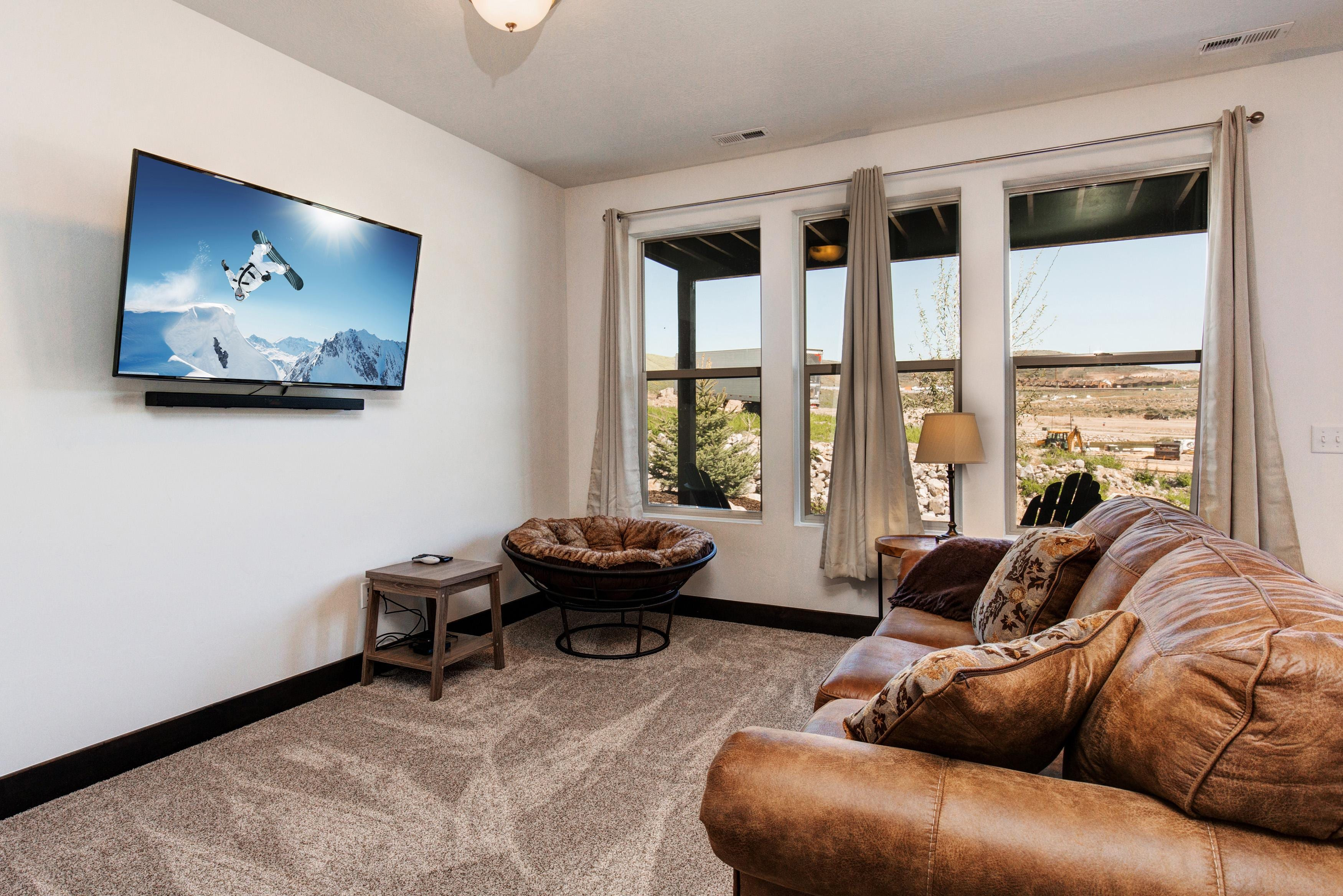 "The family room has a 55"" flat screen TV and leather sleeper sofa."