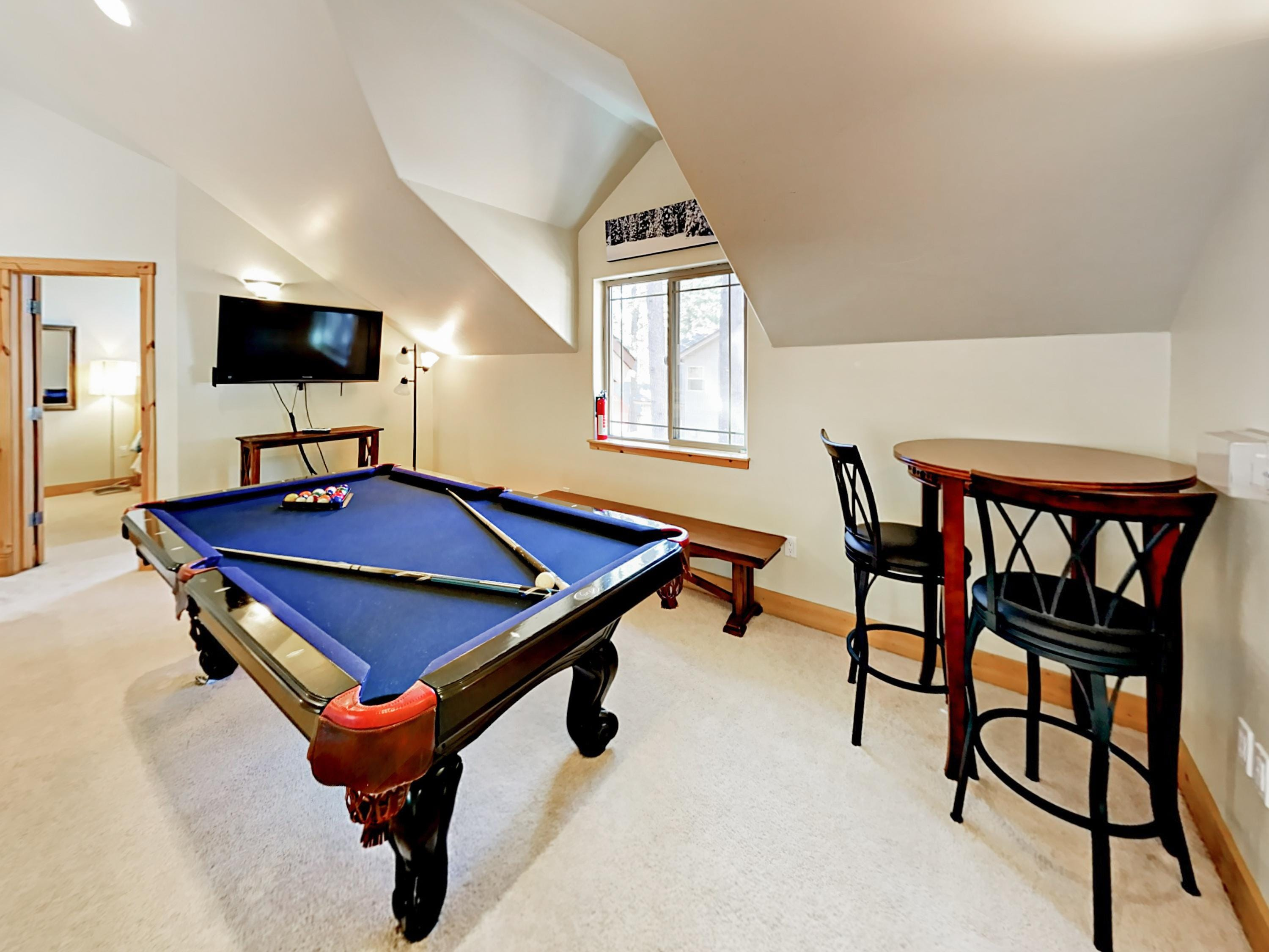 Test your billiards skills at the pool table in the game room.